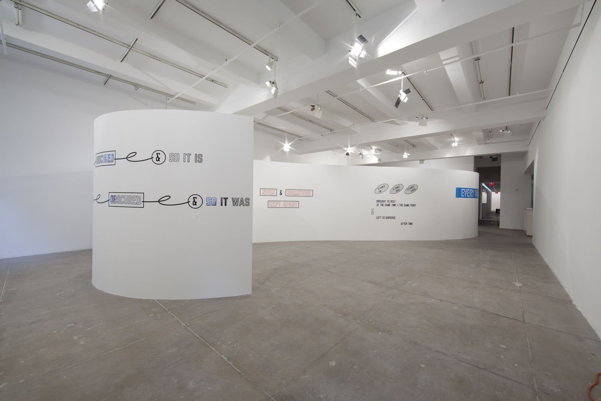 On different curved white walls, various text art has been pasted, reading things like: SO IT IS, and SO IT WAS.