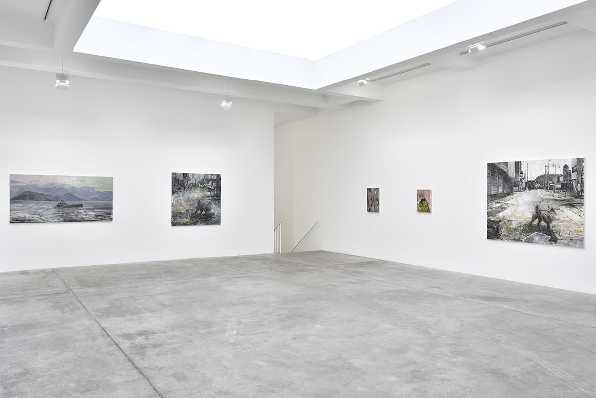 In a large white space, several expressionist oil paintings of various sizes and subjects hang.