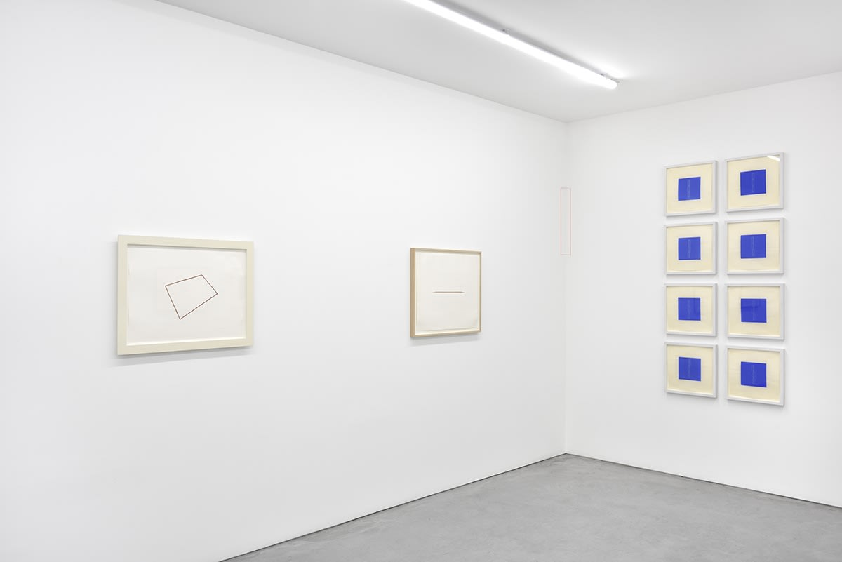 An assortment of small, framed artworks hang in the corner of the gallery. A rectangle is drawn between them.