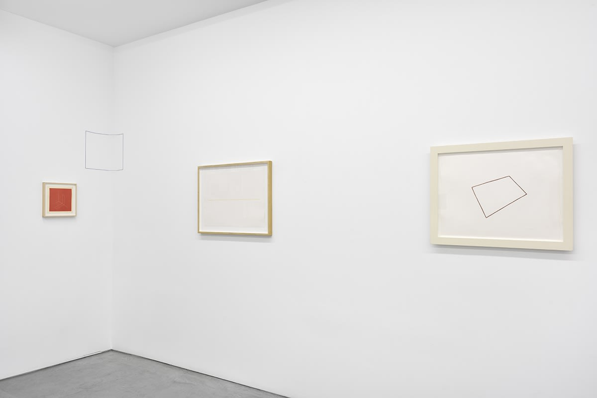 3 small, framed artworks hang in the corner of the gallery. A rectangle is drawn between them.