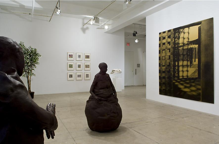 An installation view of two sculptures, 9 framed photographs, a plant and a large canvas in a white gallery space.