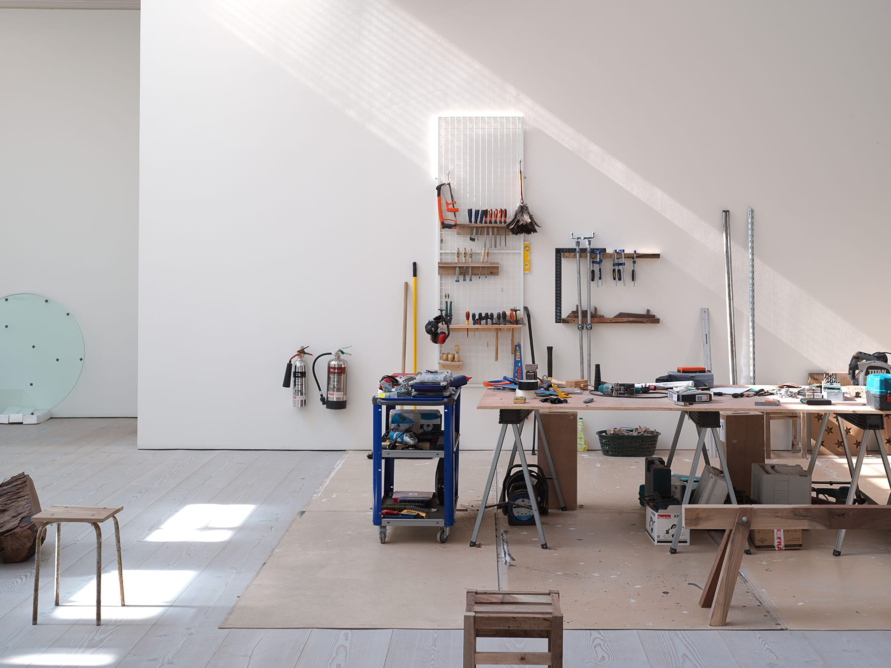 Gallery filled with tools and working benches.