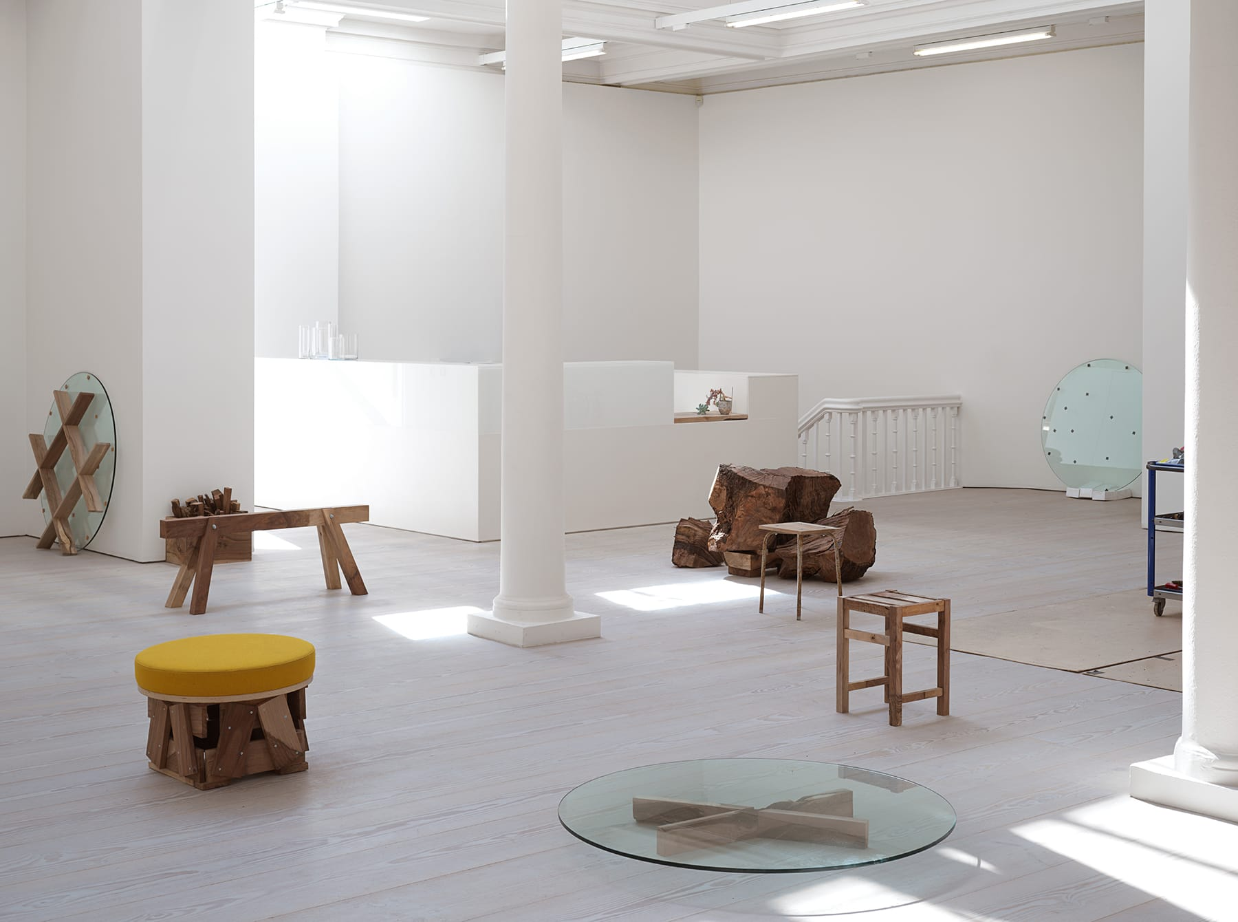 Gallery filled with various wooden furniture.