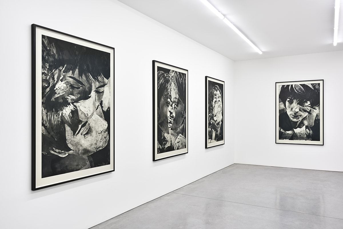 Gallery view of four vertical black and white painted portraits.