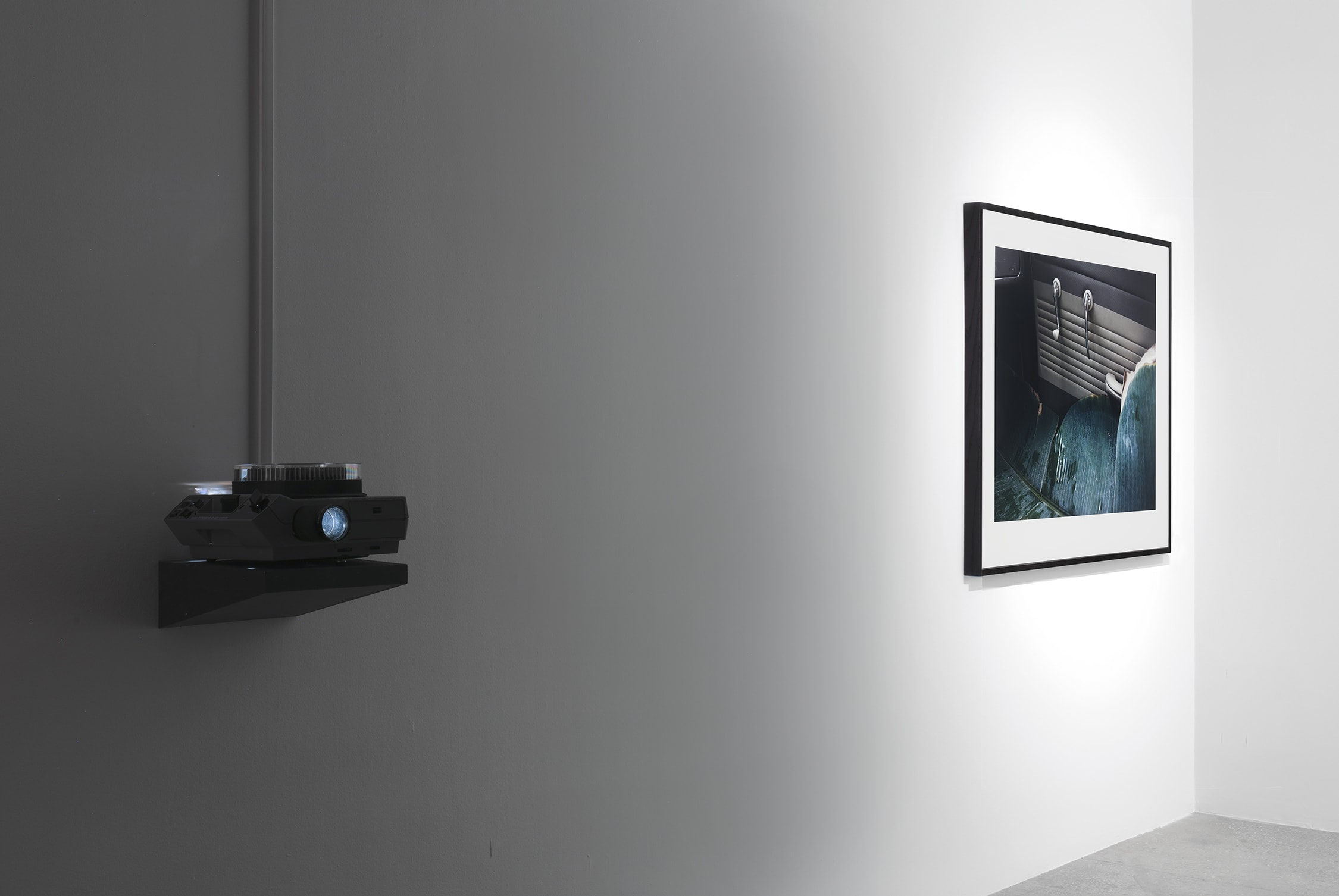 view of a projector and a photograph by Lothar Baumgarten