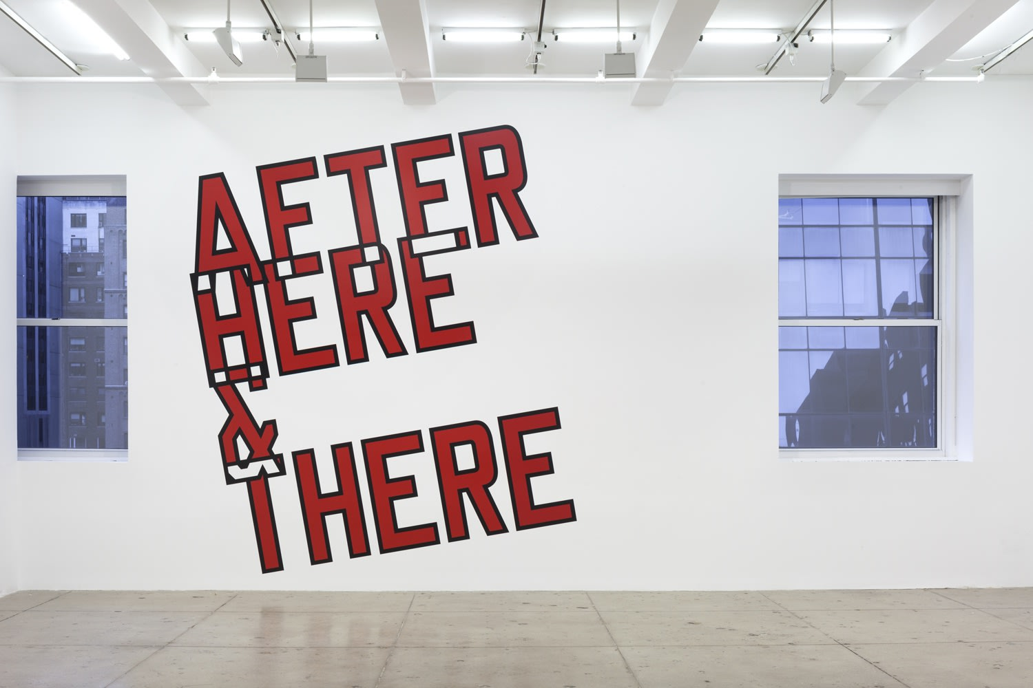 "Maroon text with a black outline on wall reading ""AFTER HERE & THERE"""