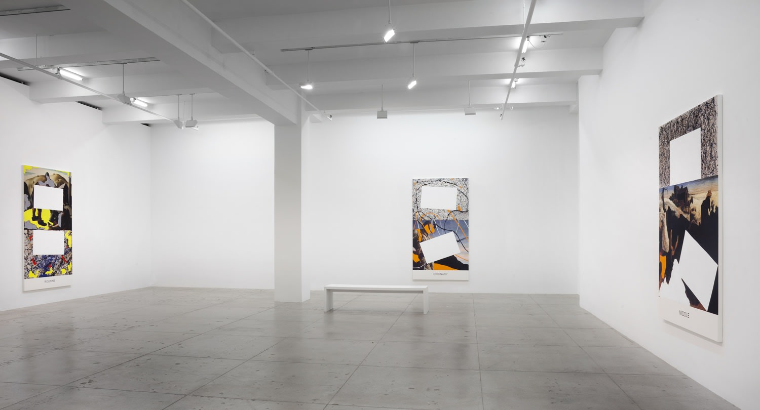 3 paintings partially covered with white rectangles hanging in a gallery space.