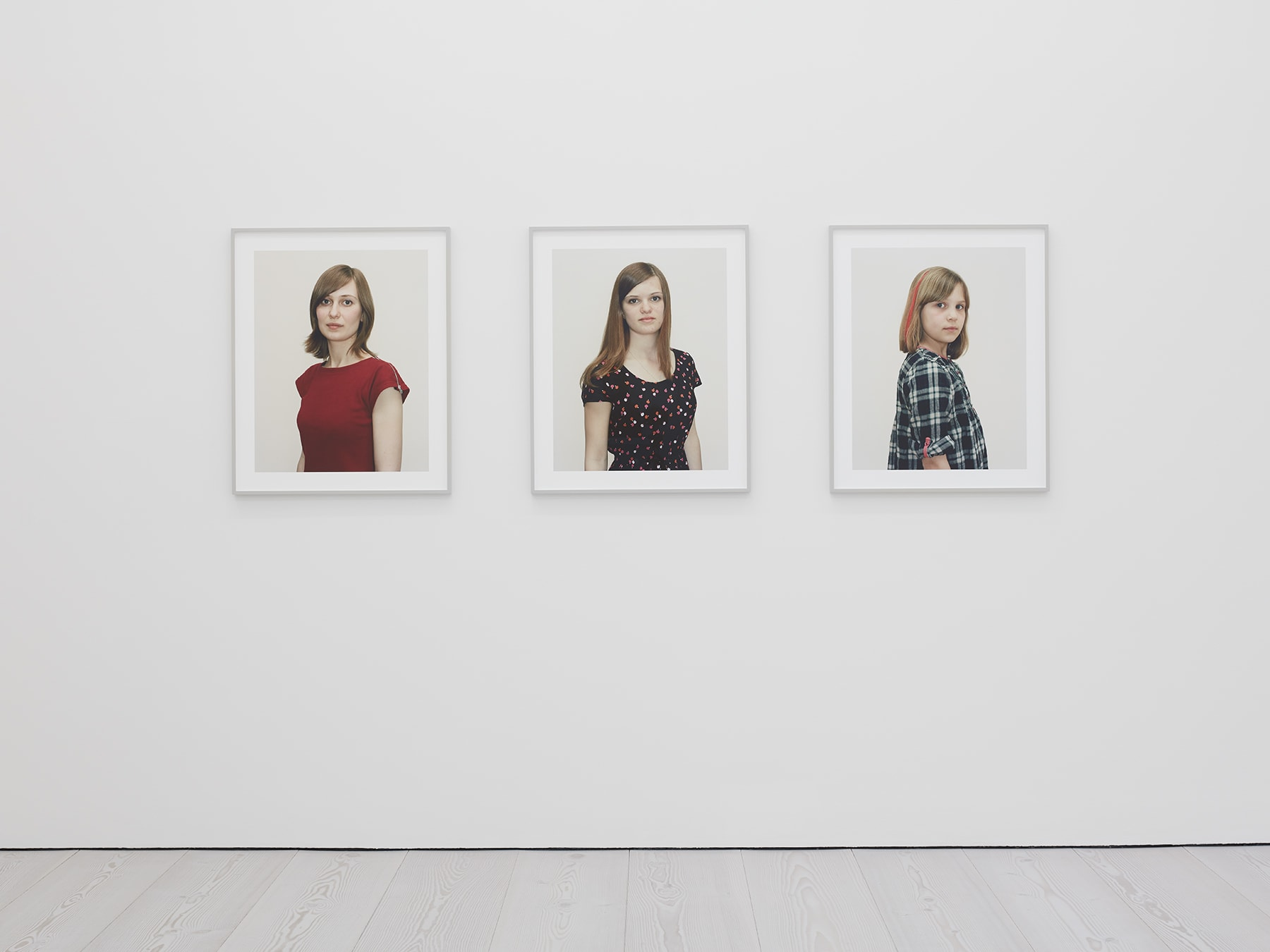 3 framed portraits in Rineke Dijkstra's exhibition at Marian Goodman Gallery, London, March 2020