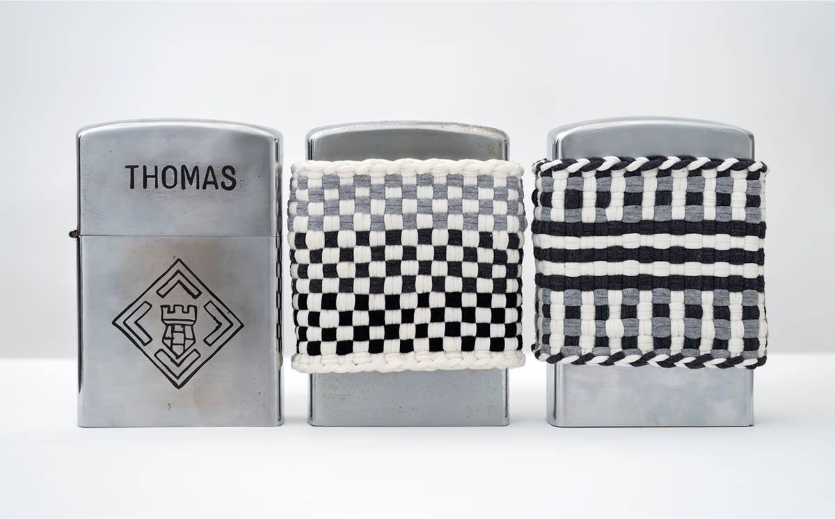 three silver lighters designed by An-My Lê