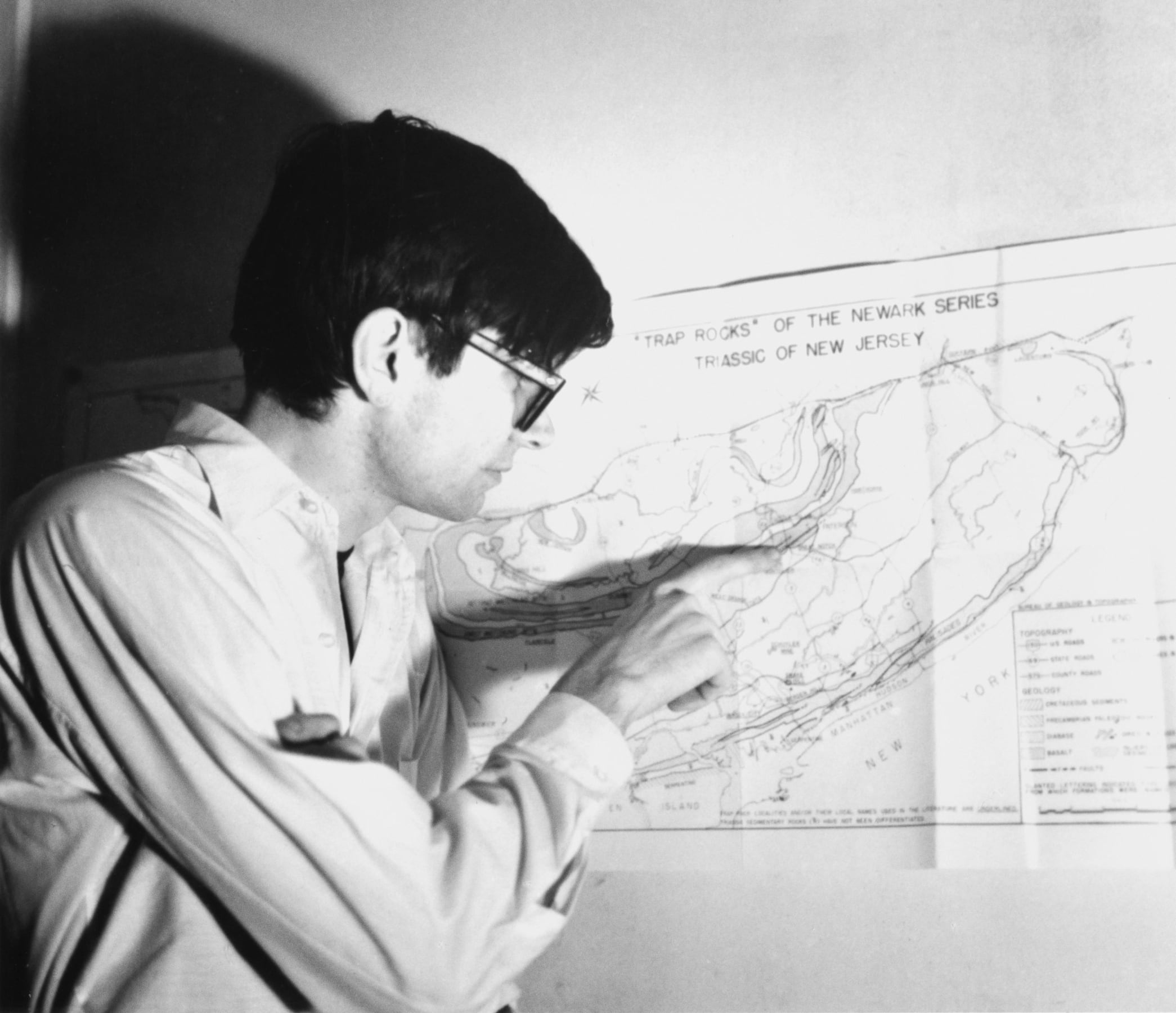 Robert Smithson pointing to a place on a map