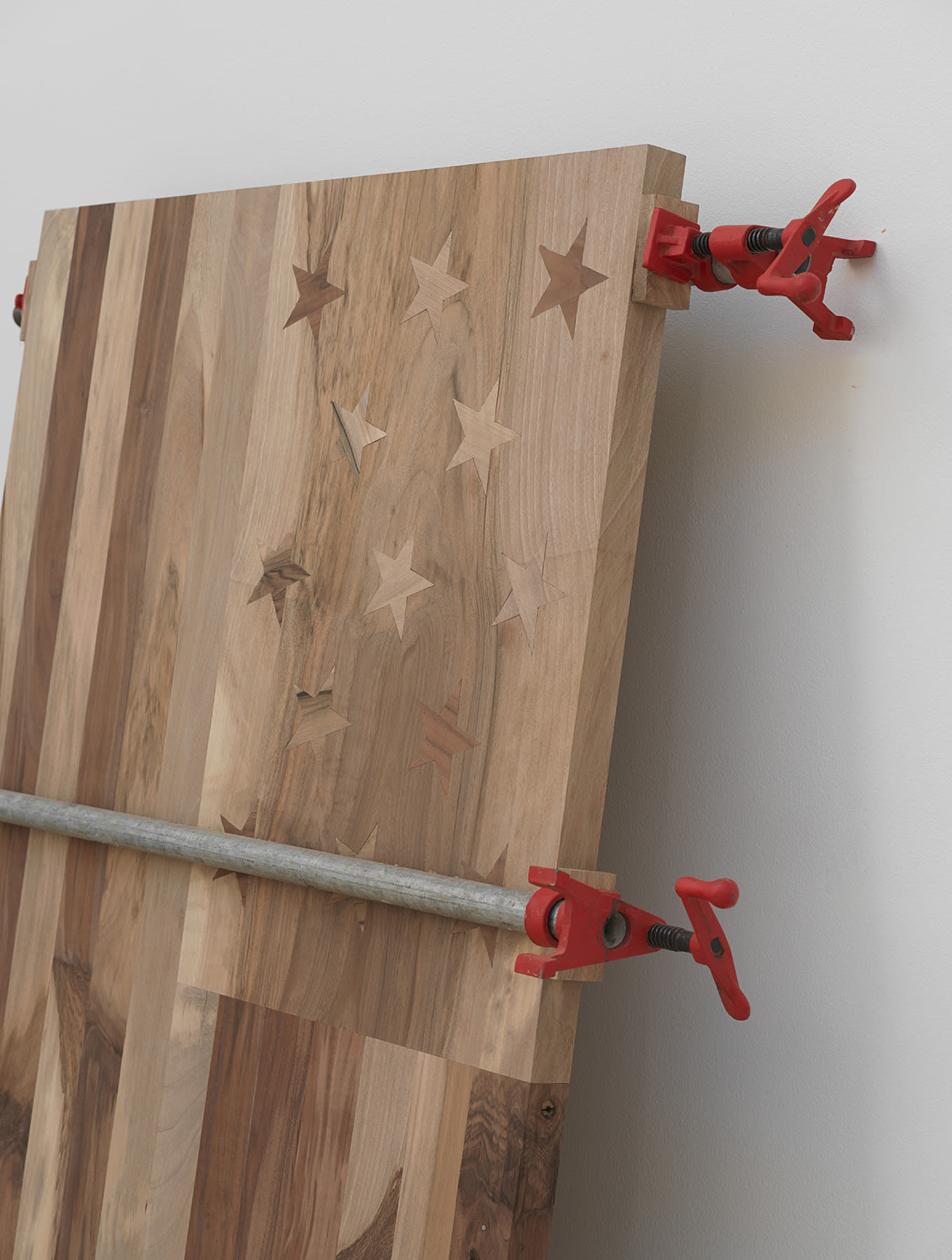 Install view of wooden American flag.