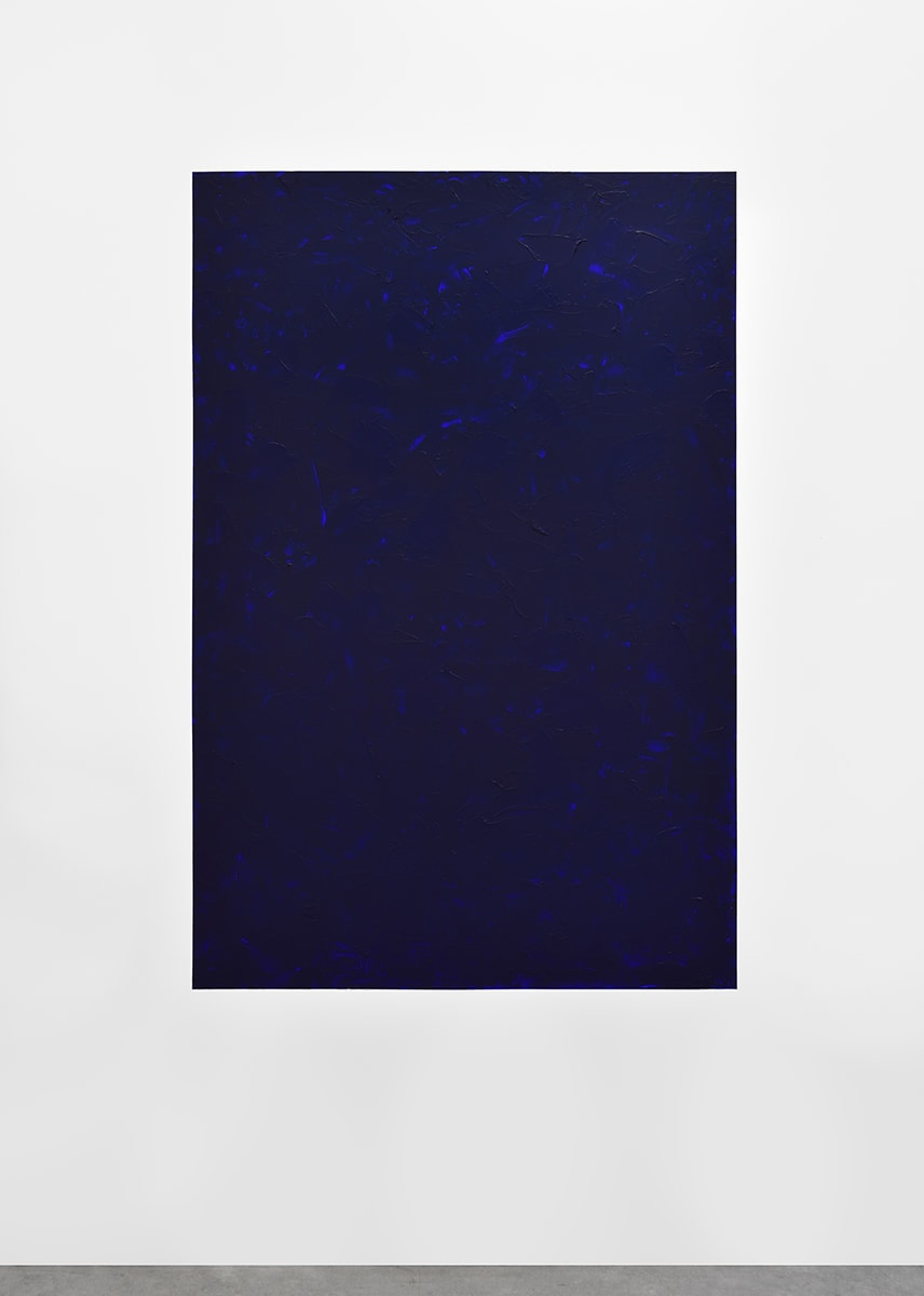installation of textured deep blue painting