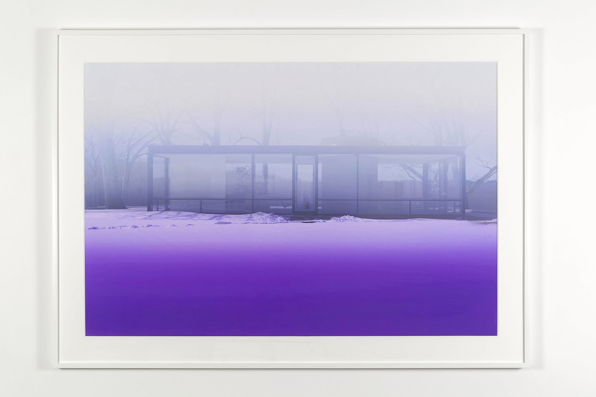 Monochromatic purple photograph of a rectangular glass building in a winter landscape on an overcast day.