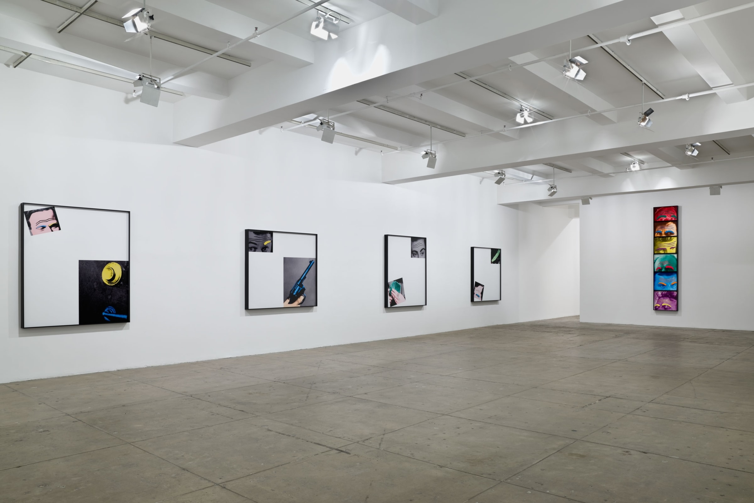 Four large framed photographs depict collage-like diptychs on the left wall; six framed images of foreheads colored like the rainbow are stacked on the right wall.