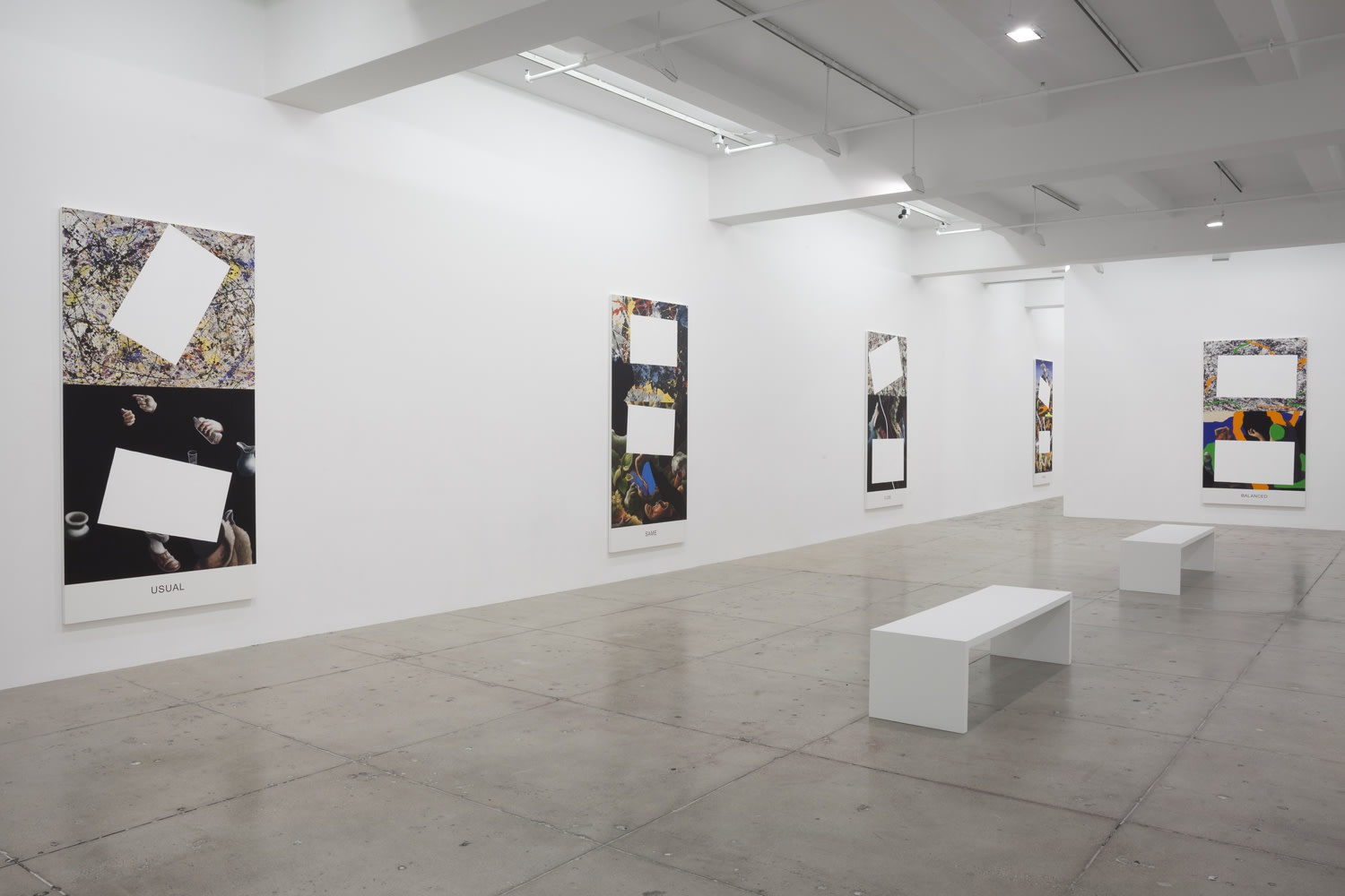 5 paintings partially covered with white rectangles hanging in a gallery space with 2 white benches.