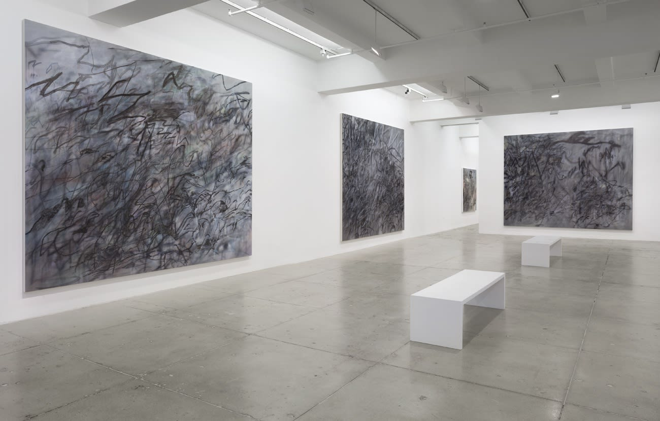 3 large abstract paintings hang in a white gallery space with 2 benches.