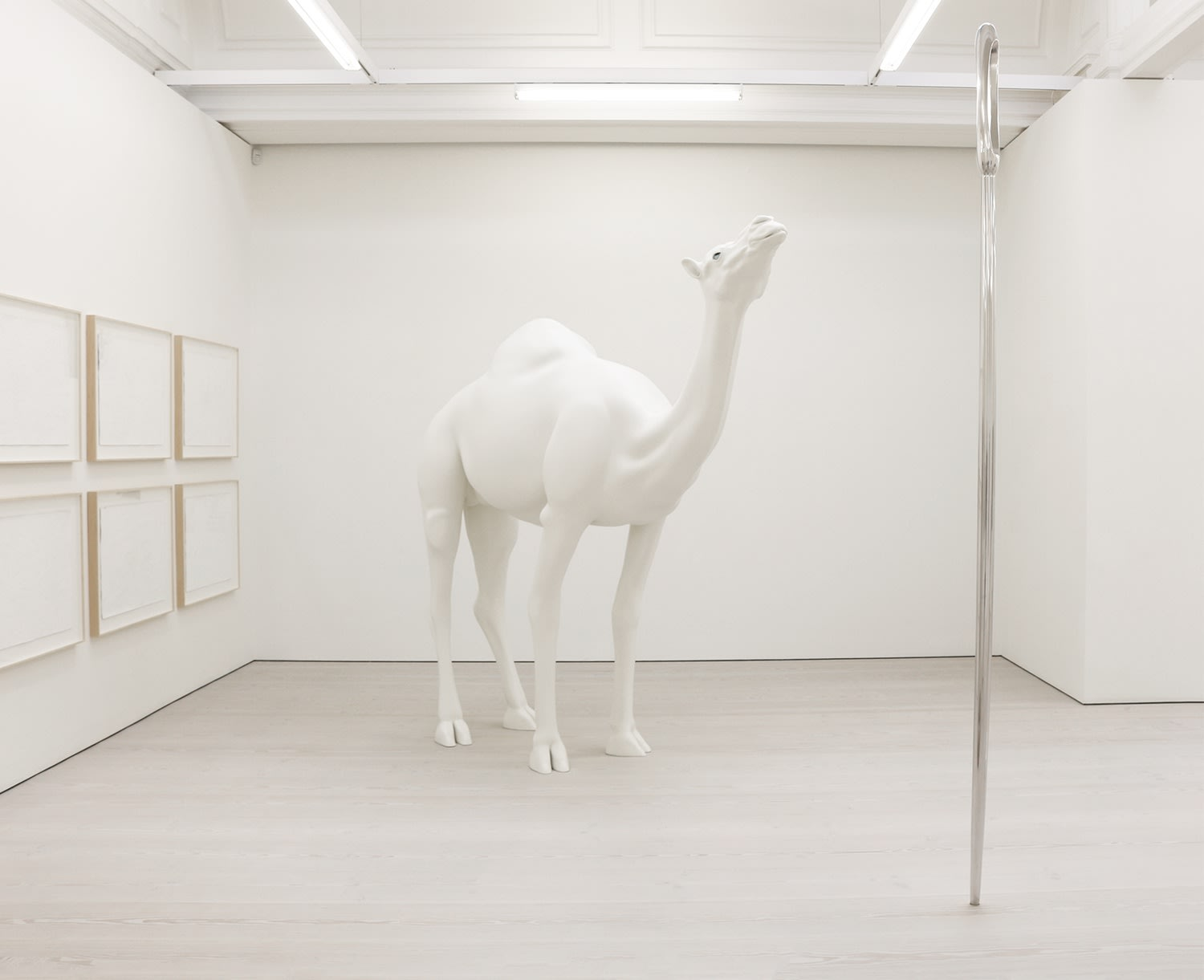 Gallery view of white camel statue with blue eyes.