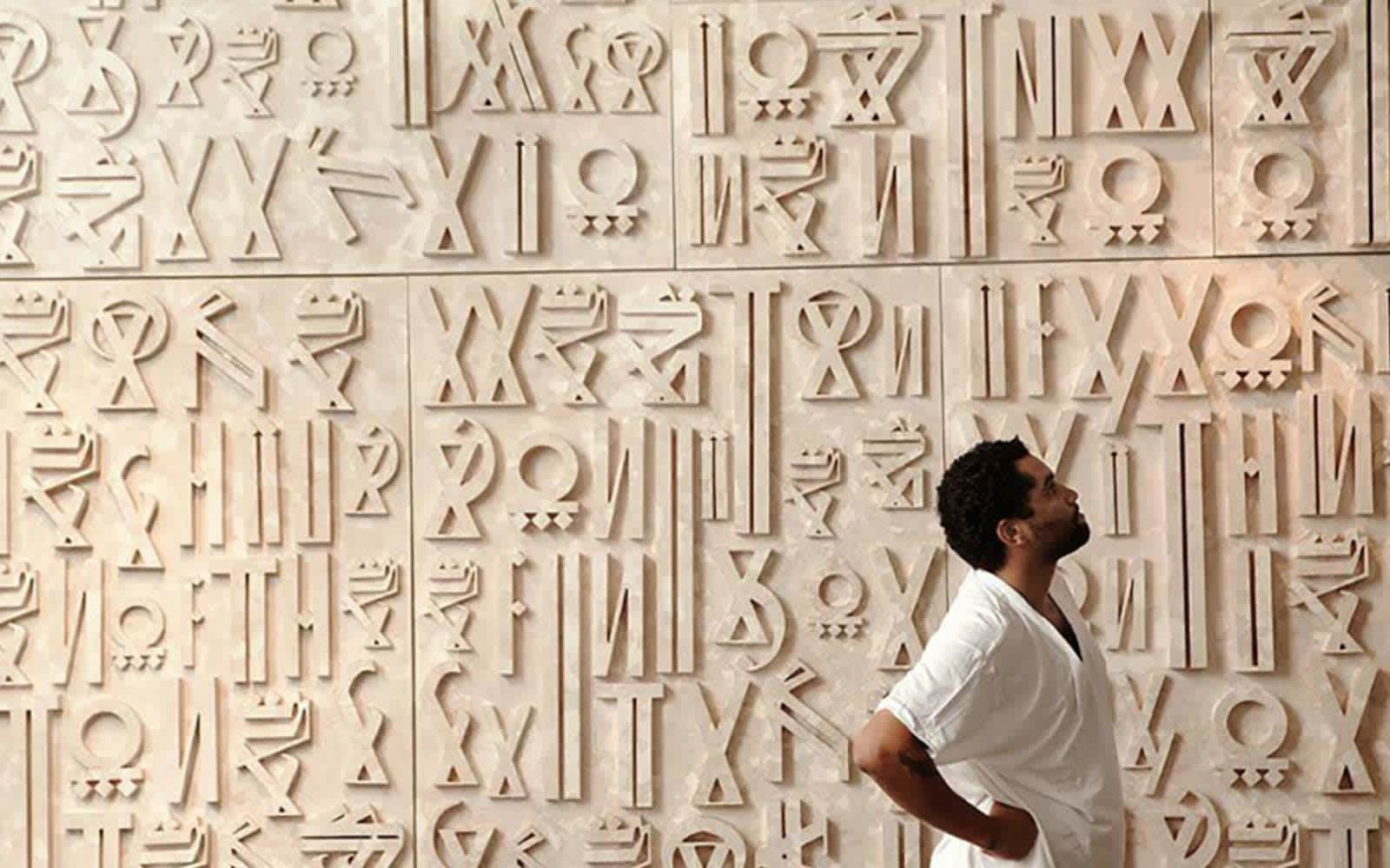 5 Things to know about RETNA, An artist that has collaborated with super brands Chanel, Louis Vuitton and Nike.