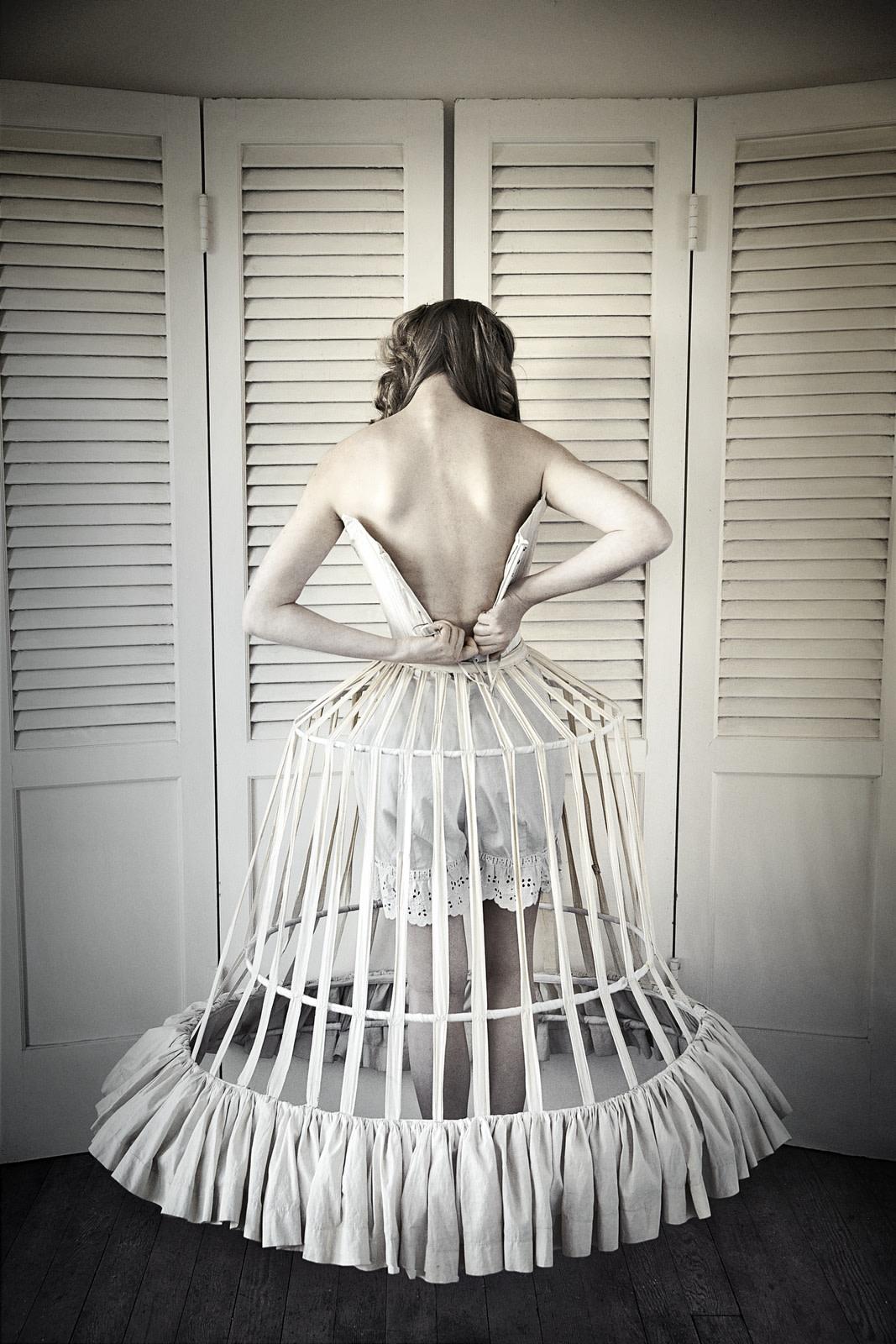 "<span class=""link fancybox-details-link""><a href=""/exhibitions/34/works/artworks452/"">View Detail Page</a></span><div class=""artist""><strong>Elisabeth Caren</strong></div><div class=""title""><em>Cage Crinoline</em>, 2013</div><div class=""medium"">C-Print, decked and floating in a white wood frame</div><div class=""dimensions"">74.6 x 57.1 cm<br>29 3/8 x 22 1/2 in.</div><div class=""edition_details"">Edition of 6</div>"