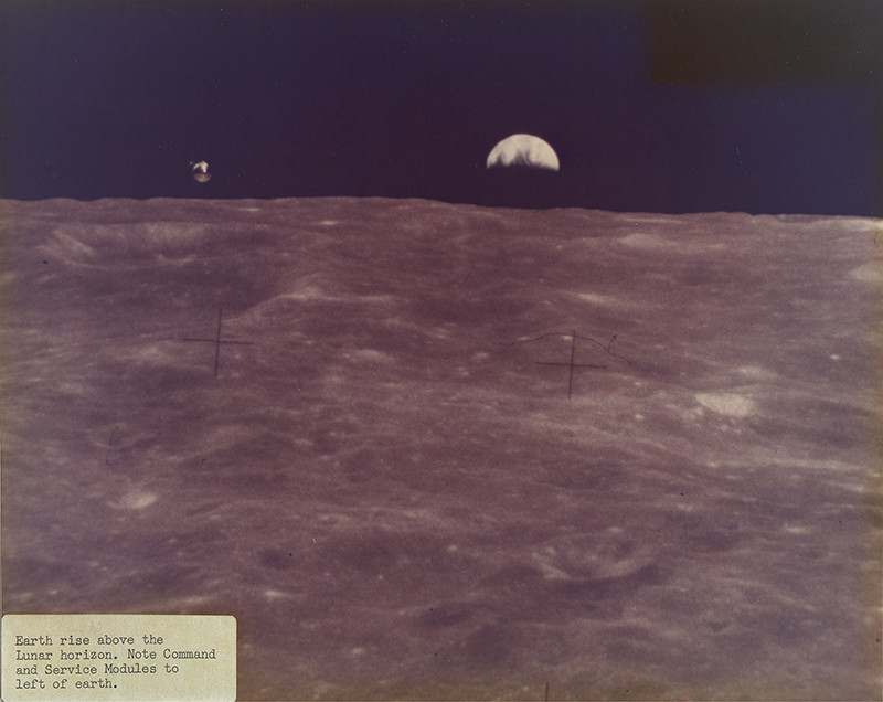 "<span class=""link fancybox-details-link""><a href=""/exhibitions/36/works/artworks34621/"">View Detail Page</a></span><div class=""signed_and_dated"">Captioned ""Earth rise above the Lunar horizon. Note Command and Service Modules to left of Earth."", in ink, on label, adhered, au recto<br /> Annotated, in ink, au verso<br /> Photo ID 72HC434<br /> Printed circa 1973 from official NASA copy negative</div> <div class=""medium"">Chromogenic print</div> <div class=""dimensions"">7 ⅞ x 9 ⅞ inch (20.00 x 25.08 cm)</div>"