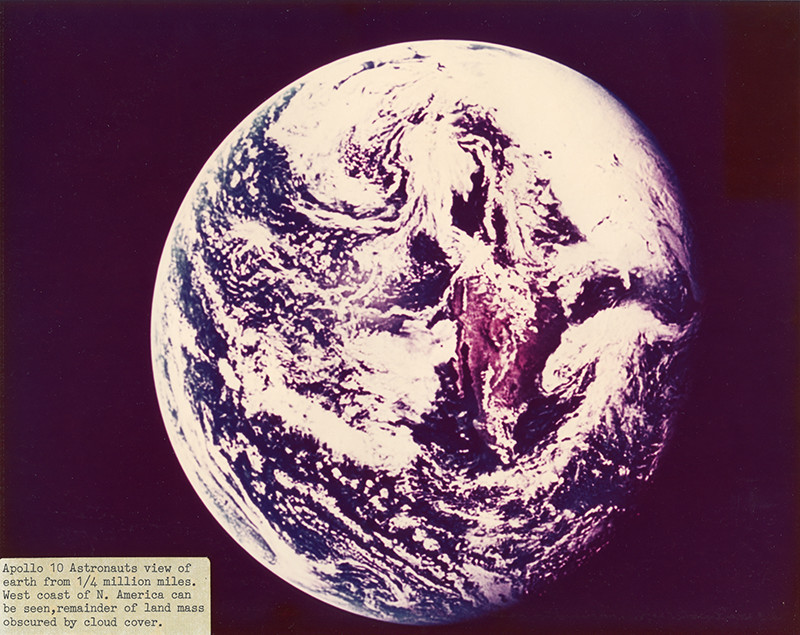 """<span class=""""link fancybox-details-link""""><a href=""""/exhibitions/36/works/artworks34596/"""">View Detail Page</a></span><div class=""""signed_and_dated"""">Captioned """"Apollo 10 Astronauts view of Earth from ¼ million miles. West coast of N. America can be seen, remainder of land mass obscured by cloud cover."""", in ink, on label, adhered, au recto<br /> Annotated, in ink, au verso<br /> Photo ID 69HC487<br /> Printed circa 1970 from official NASA copy negative</div> <div class=""""medium"""">Chromogenic print</div> <div class=""""dimensions"""">8 x 10 inch (20.32 x 25.40 cm)</div>"""