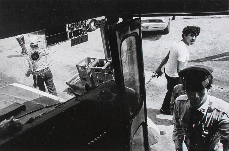"""<span class=""""link fancybox-details-link""""><a href=""""/exhibitions/61/works/artworks35015/"""">View Detail Page</a></span><div class=""""signed_and_dated"""">Signed, titled, dated, and annotated """"National police boarding a bus, Guatemala City, Guatemala"""", in pencil, au verso<br /> Printed in 1987</div> <div class=""""medium"""">Gelatin silver print</div> <div class=""""dimensions"""">7 ½ x 11 ¼ inch (19.05 x 28.58 cm) image<br /> 10 ¾ x 13 ¾ inch (27.31 x 34.93 cm) paper</div> <div class=""""edition_details""""></div>"""