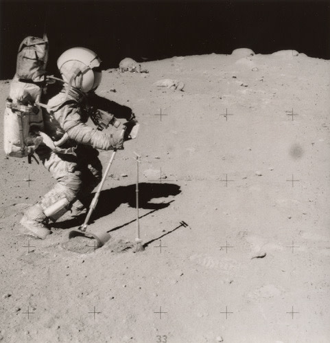 "<span class=""link fancybox-details-link""><a href=""/exhibitions/36/works/artworks19775/"">View Detail Page</a></span><div class=""signed_and_dated"">Astronaut David R. Scott, commander, standing on the slope of Hadley Delta, uses a 70mm camera during Apollo 15 extravehicular activity (EVA) on the lunar surface. He is 10.5 miles (or 17.5 kilometers) from the base of the Apennine Mountains seen in the background. Scott carries tongs in his left hand. The Lunar Roving Vehicle (LRV) is in the background. This view is looking east. While astronauts Scott and James B. Irwin, lunar module pilot, descended in the Lunar Module (LM) ""Falcon"" to explore the moon, astronaut Alfred M. Worden, command module pilot, remained with the Command and Service Modules (CSM) in lunar orbit.<br /> Photo ID ""AS16-106-17340"", printed as part of image, au recto<br /> Printed in 1972</div> <div class=""medium"">Gelatin silver print</div> <div class=""dimensions"">7 ¼ x 7 inch (18.42 x 17.78 cm) image<br /> 8 x 10 inch (20.32 x 25.4 cm) paper</div> <div class=""edition_details""></div>"
