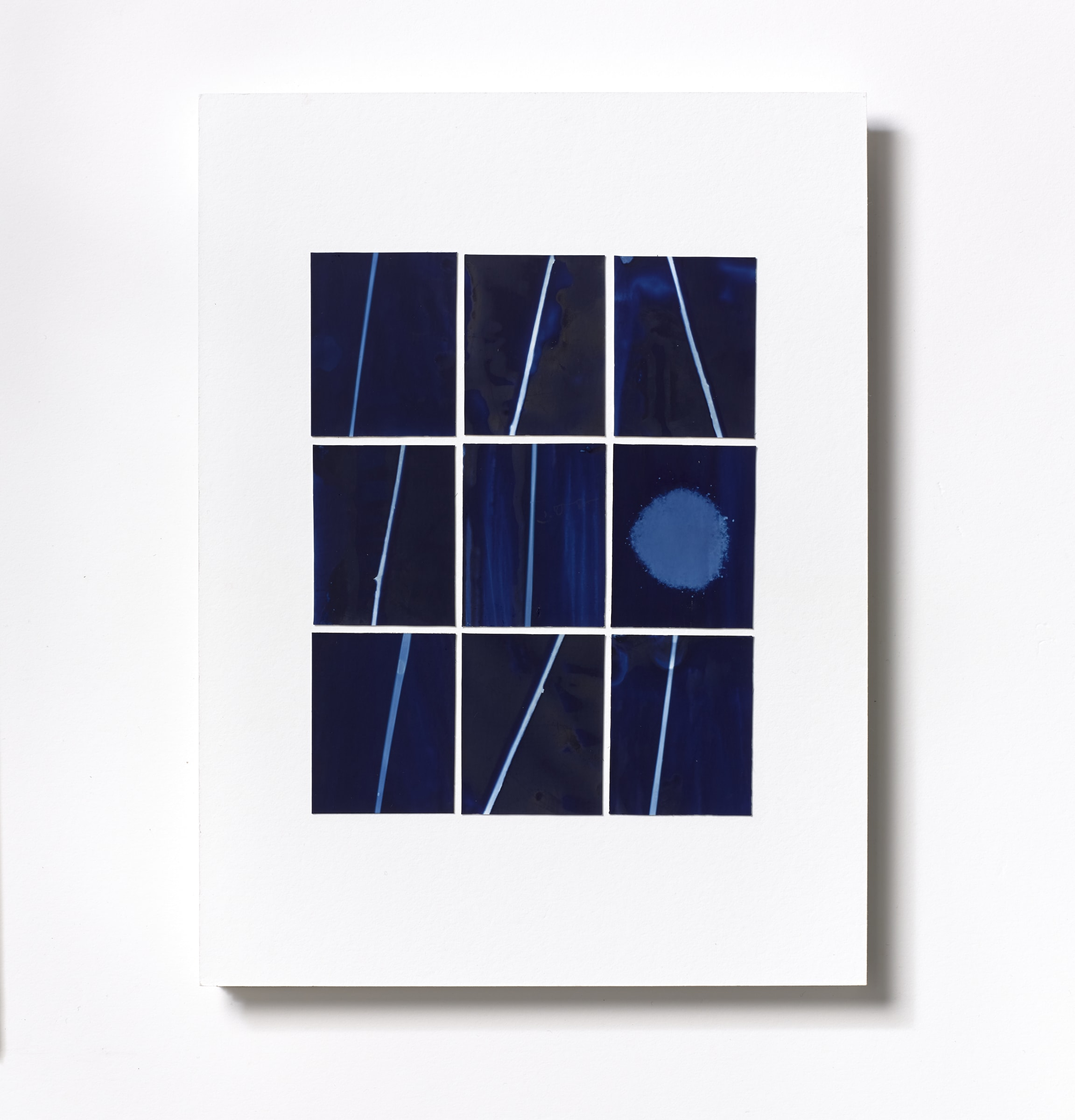 """<span class=""""link fancybox-details-link""""><a href=""""/content/feature/125/artworks573/"""">View Detail Page</a></span><div class=""""medium"""">Cyanotype Collage of nine hand-painted 2 7/8"""" x 1 7/8"""" cyanotype photograms on a 12 x 9 inch 8-ply museum board<br /> Print only<br /> Unique</div> <div class=""""dimensions"""">30.5 x 22.9 cm<br /> 12 x 9 in</div>"""