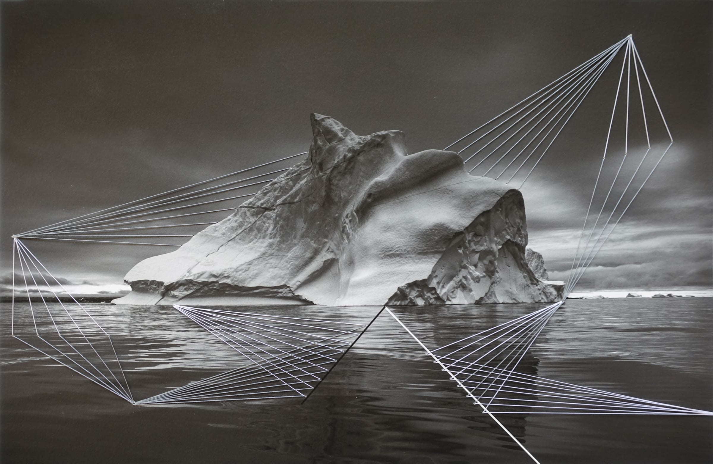 """<span class=""""link fancybox-details-link""""><a href=""""/artists/52-adriene-hughes/works/894-adriene-hughes-threaded-iceberg-bw-no.-3-2019/"""">View Detail Page</a></span><div class=""""artist""""><strong>Adriene Hughes</strong></div> <div class=""""title""""><em>Threaded Iceberg BW No. 3</em>, 2019</div> <div class=""""medium"""">Archival Pigment Print on Cotton Rag with Cotton Quilting Thread<br /> Print only<br /> Unique</div> <div class=""""dimensions"""">20.3 x 30.5 cm<br /> 8 x 12 in</div><div class=""""copyright_line"""">Copyright Adriene Hughes<br></div>"""