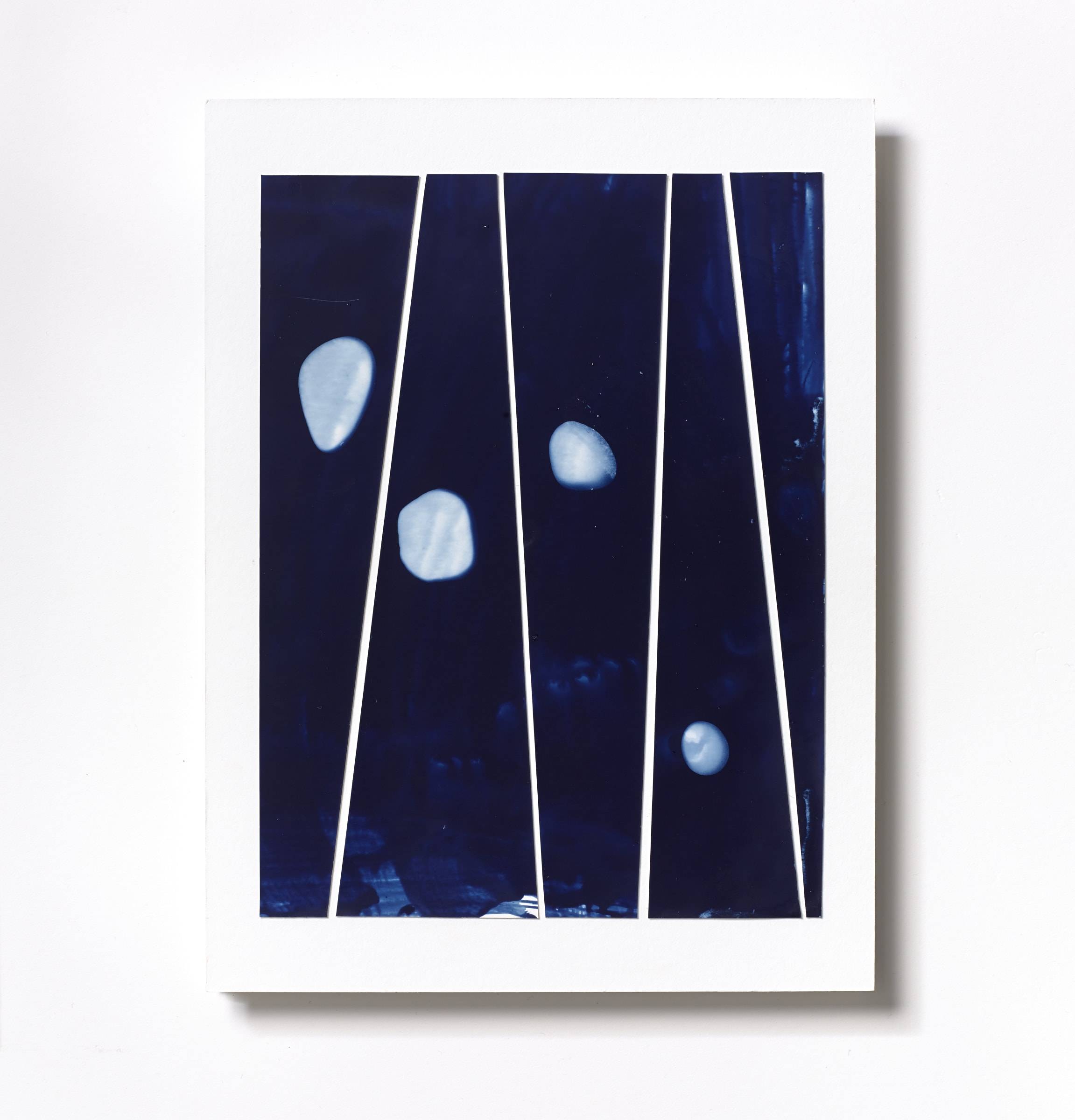 """<span class=""""link fancybox-details-link""""><a href=""""/content/feature/218/artworks559/"""">View Detail Page</a></span><div class=""""medium"""">Cyanotype Collage of five hand-painted 9 7/8"""" x 1/4"""" cyanotype photograms on a 12 x 9 inch 8-ply museum board.<br /> Print only<br /> Unique</div> <div class=""""dimensions"""">30.5 x 22.9 cm<br /> 12 x 9 in</div>"""