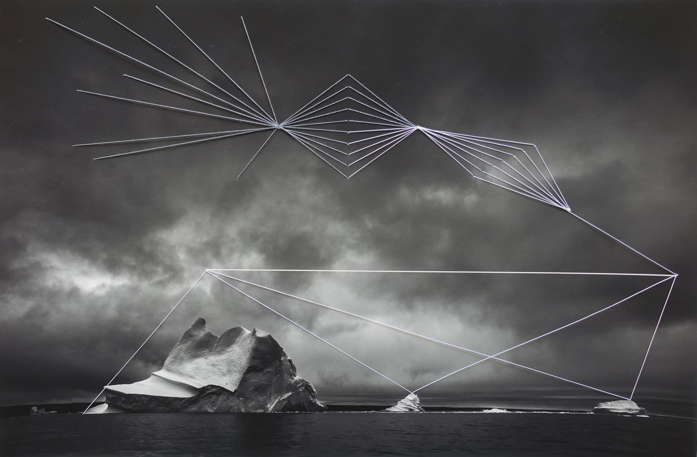 """<span class=""""link fancybox-details-link""""><a href=""""/artists/52-adriene-hughes/works/892-adriene-hughes-threaded-iceberg-bw-no.-2-2019/"""">View Detail Page</a></span><div class=""""artist""""><strong>Adriene Hughes</strong></div> <div class=""""title""""><em>Threaded Iceberg BW No. 2</em>, 2019</div> <div class=""""medium"""">Archival Pigment Print on Cotton Rag with Cotton Quilting Thread<br /> Print only<br /> Unique</div> <div class=""""dimensions"""">20.3 x 30.5 cm<br /> 8 x 12 in</div><div class=""""copyright_line"""">Copyright Adriene Hughes<br></div>"""