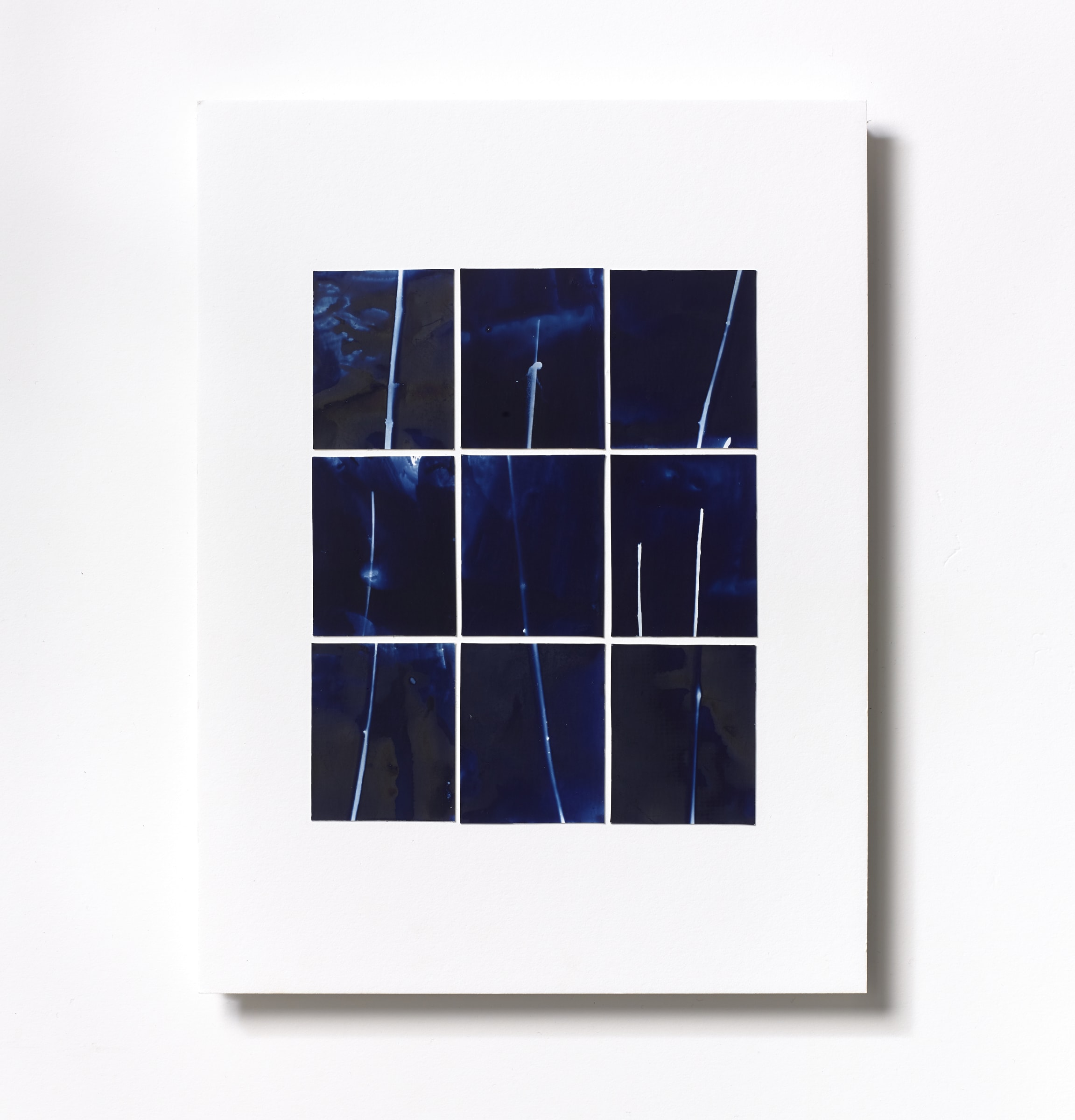 """<span class=""""link fancybox-details-link""""><a href=""""/content/feature/125/artworks574/"""">View Detail Page</a></span><div class=""""medium"""">Cyanotype Collage of nine hand-painted 2 7/8"""" x 1 7/8"""" cyanotype photograms on a 12 x 9 inch 8-ply museum board<br /> Print only<br /> Unique</div> <div class=""""dimensions"""">30.5 x 22.9 cm<br /> 12 x 9 in</div>"""