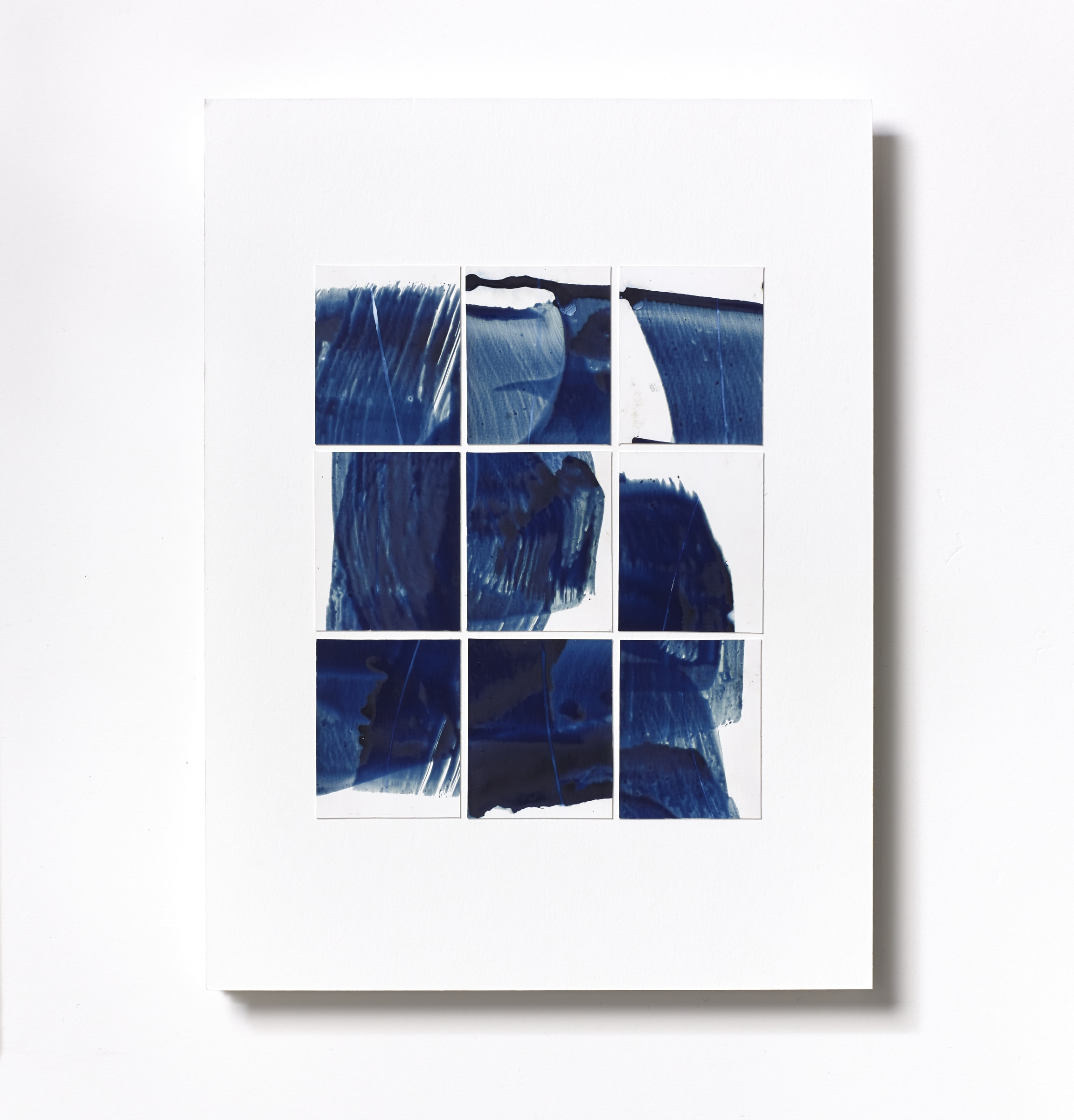 """<span class=""""link fancybox-details-link""""><a href=""""/content/feature/218/artworks575/"""">View Detail Page</a></span><div class=""""medium"""">Cyanotype Collage of nine hand-painted 2 7/8"""" x 1 7/8"""" cyanotype photograms on a 12 x 9 inch 8-ply museum board<br /> Print only<br /> Unique</div> <div class=""""dimensions"""">30.5 x 22.9 cm<br /> 12 x 9 in</div>"""