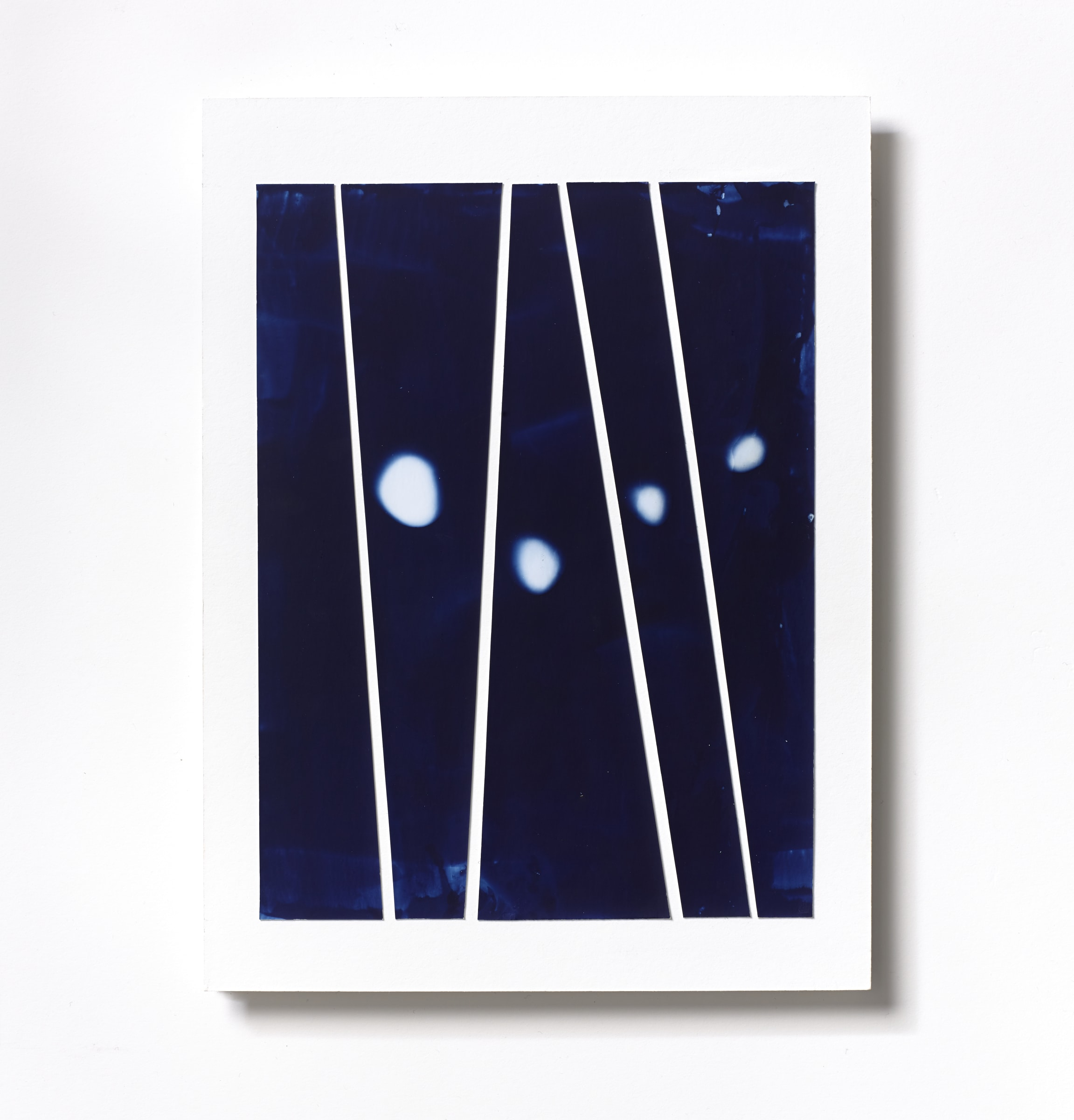 """<span class=""""link fancybox-details-link""""><a href=""""/content/feature/118/artworks558/"""">View Detail Page</a></span><div class=""""medium"""">Cyanotype Collage of five hand-painted 9 7/8"""" x 1/4"""" cyanotype photograms on a 12 x 9 inch 8-ply museum board.<br /> Print only<br /> Unique</div> <div class=""""dimensions"""">30.5 x 22.9 cm<br /> 12 x 9 in</div>"""
