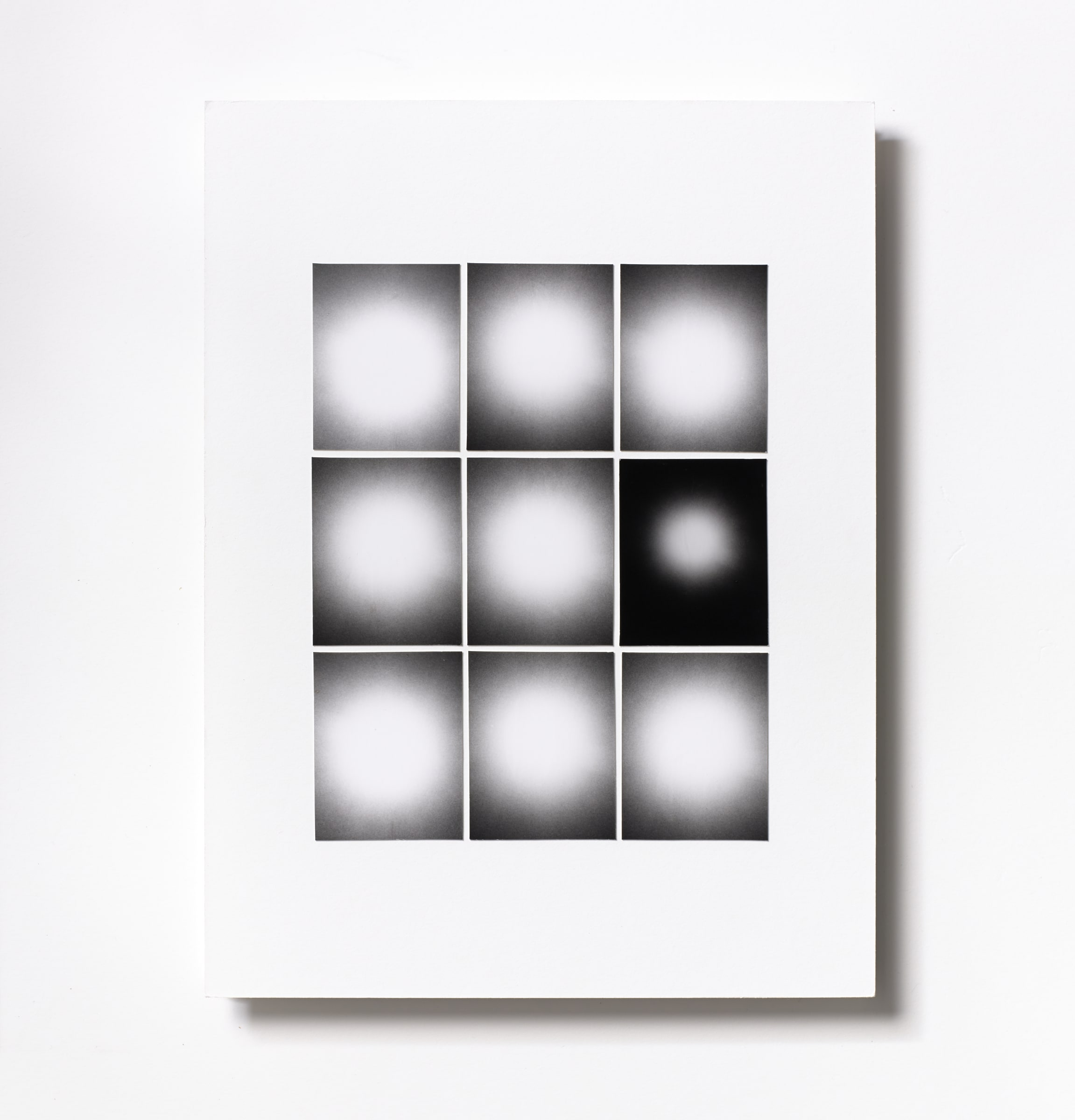 "<span class=""link fancybox-details-link""><a href=""/content/feature/114/artworks547/"">View Detail Page</a></span><div class=""medium"">Silver Gelatin Photogram Print Collage of nine handmade 2.5"" x 2"" silver gelatin prints from film negatives on a 12 x 9 inch 8-ply museum board.<br /> Unique<br /> Floated in a handmade white box frame with Optium Museum Acrylic glaze</div> <div class=""dimensions"">30.5 x 22.9 cm<br /> 12 x 9 in</div>"