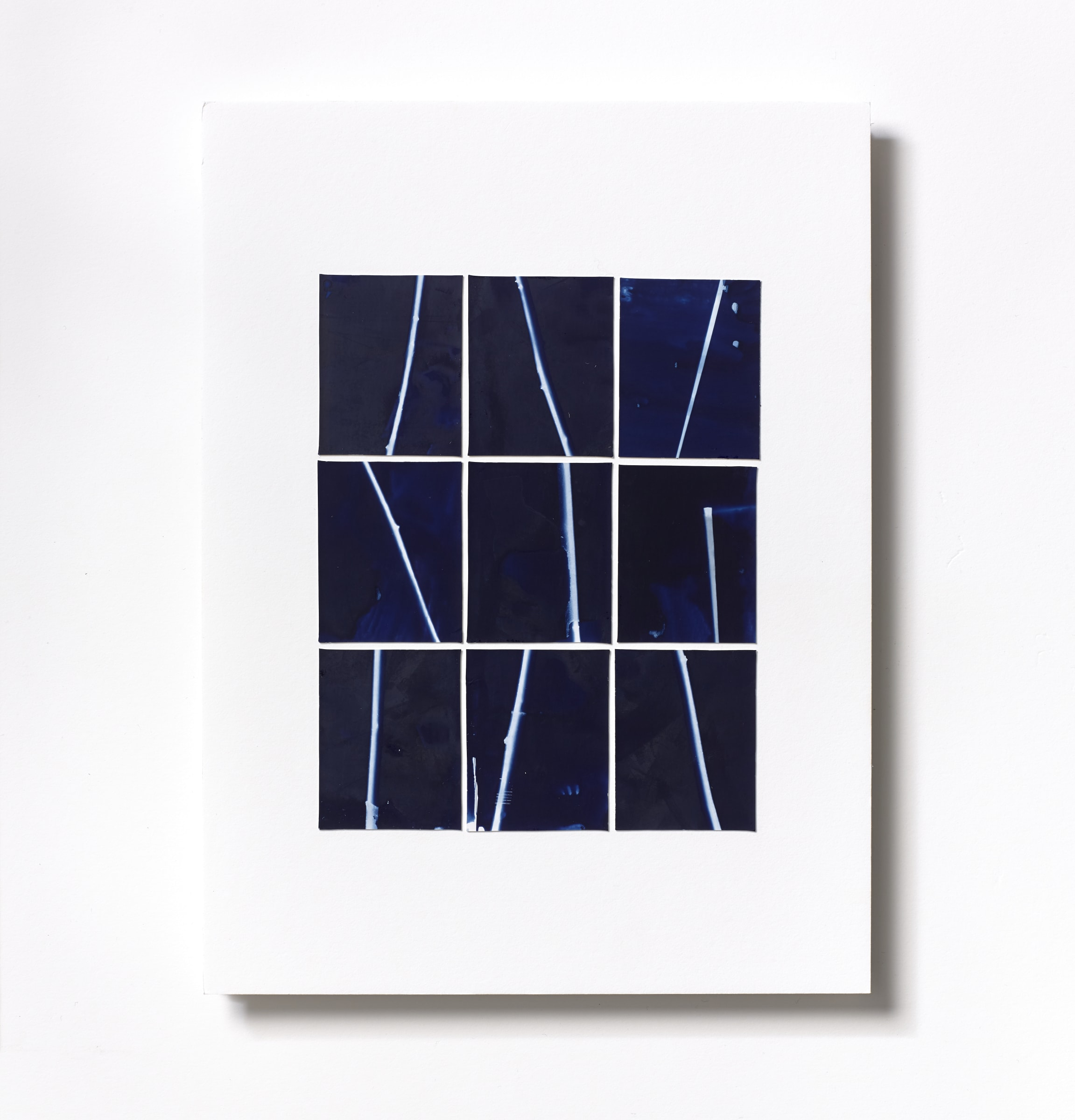 """<span class=""""link fancybox-details-link""""><a href=""""/content/feature/125/artworks572/"""">View Detail Page</a></span><div class=""""medium"""">Cyanotype Collage of nine hand-painted 2 7/8"""" x 1 7/8"""" cyanotype photograms on a 12 x 9 inch 8-ply museum board<br /> Print only<br /> Unique</div> <div class=""""dimensions"""">30.5 x 22.9 cm<br /> 12 x 9 in</div>"""