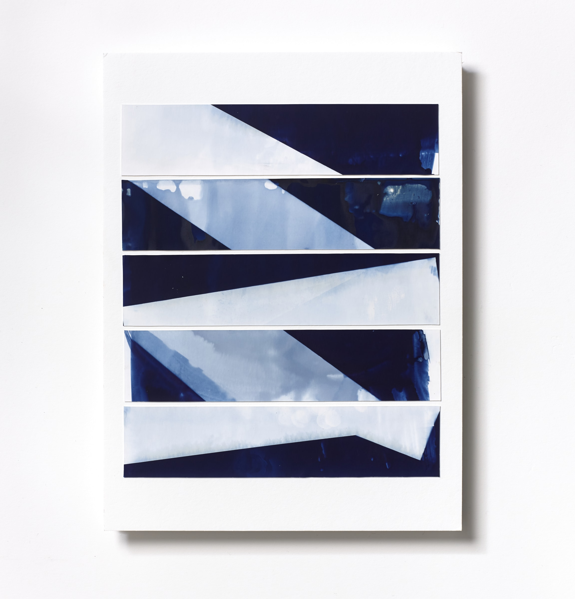 """<span class=""""link fancybox-details-link""""><a href=""""/content/feature/218/artworks563/"""">View Detail Page</a></span><div class=""""medium"""">Cyanotype Collage of five handpainted 1 3/4"""" x 7 7/8"""" cyanotype photograms on a 12 x 9 inch 8-ply museum board<br /> Print only<br /> Unique</div> <div class=""""dimensions"""">30.5 x 22.9 cm<br /> 12 x 9 in</div>"""