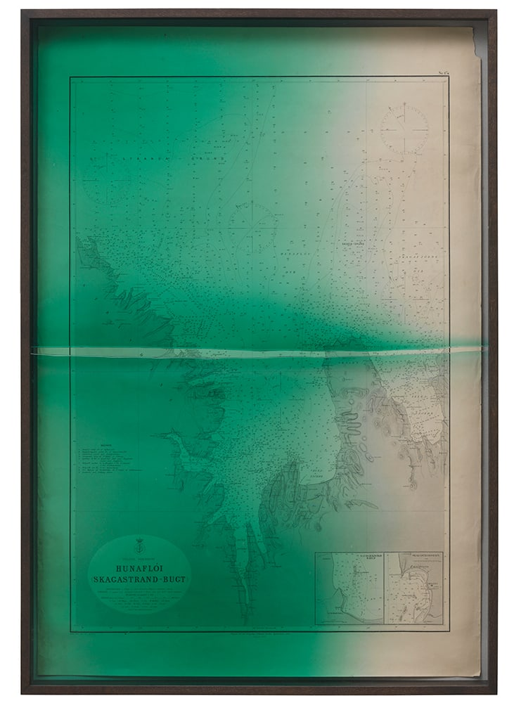 """<span class=""""link fancybox-details-link""""><a href=""""/artists/132-olafur-eliasson/works/13129/"""">View Detail Page</a></span><div class=""""artist""""><strong>ÓLAFUR ELÍASSON</strong></div> <div class=""""title""""><em>Emerging Hunaflói (Skagastrand - Bugt)</em>, 2013</div> <div class=""""medium"""">smoked oak, coloured glass (turquoise), cardboard, historical bathymetric map of Iceland (first printed in 1893) mounted on canvas</div> <div class=""""dimensions"""">110 x 76,5 x 7,5</div>"""