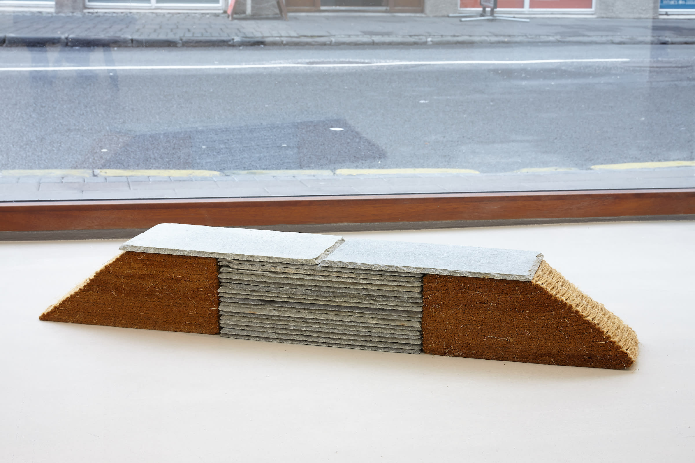 "<span class=""link fancybox-details-link""><a href=""/exhibitions/171/works/artworks10556/"">View Detail Page</a></span><div class=""artist""><strong>RAGNA RÓBERTSDÓTTIR</strong></div><div class=""title""><em>Untitled</em>, 1986</div><div class=""medium"">manilla rope, linen, slates</div><div class=""dimensions"">20 x 123 x 20 cm</div>"