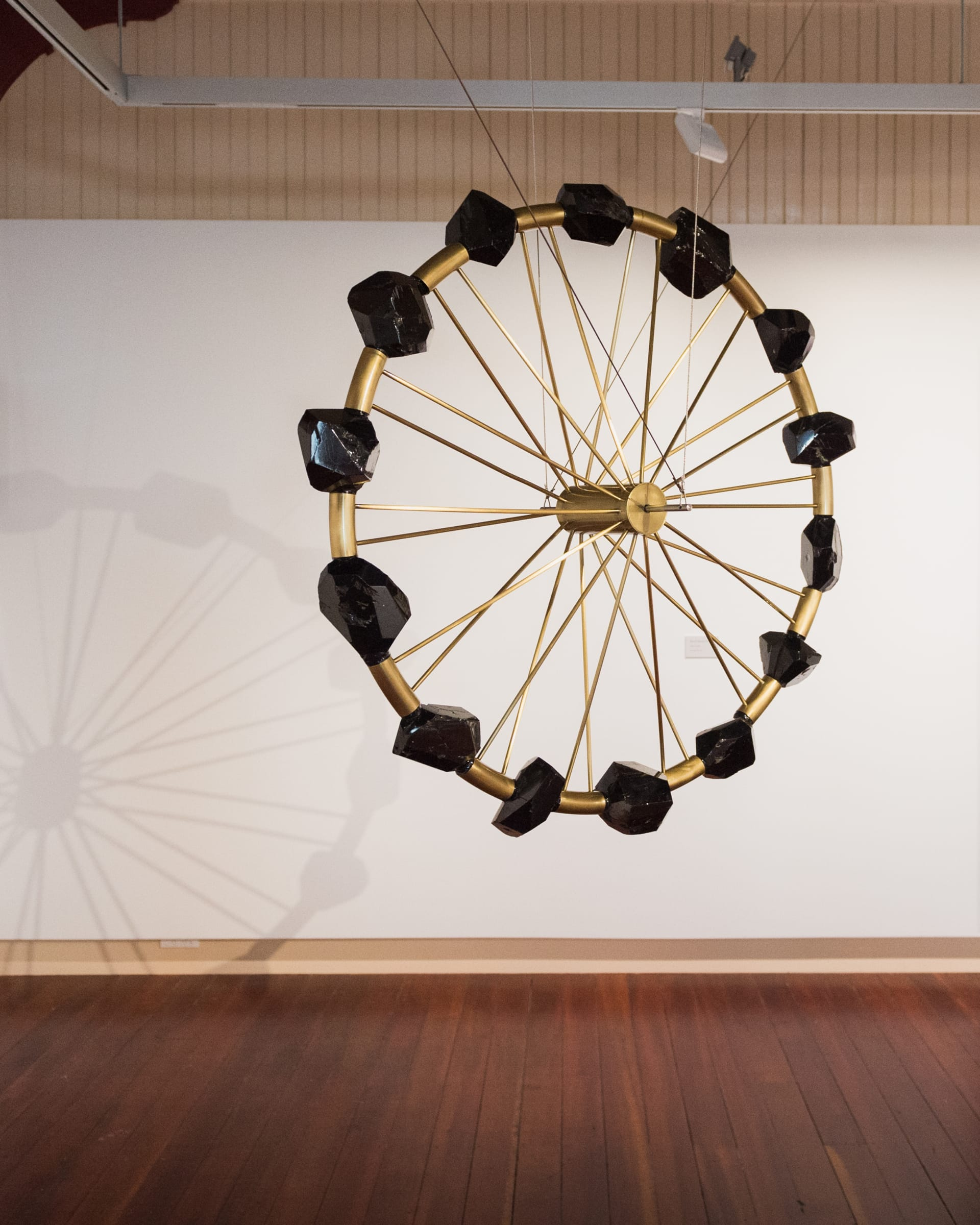 "<span class=""link fancybox-details-link""><a href=""/artists/47-andrew-drummond/works/7239-andrew-drummond-suspended-coal-wheel-1997-1998/"">View Detail Page</a></span><div class=""artist""><strong>Andrew Drummond</strong></div> <div class=""title""><em>[Suspended] Coal Wheel</em>, 1997-1998</div> <div class=""medium"">Coal, brass, machined steel, wires</div> <div class=""dimensions"">63 x 63 in<br />160 x 160 cm</div>"