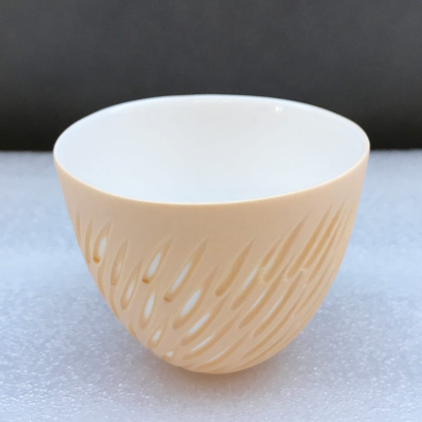 """<span class=""""link fancybox-details-link""""><a href=""""/artists/60-sasha-wardell/works/7494-sasha-wardell-shoal-tea-bowl-2021/"""">View Detail Page</a></span><div class=""""artist""""><strong>Sasha Wardell</strong></div> b. 1956 <div class=""""title""""><em>'Shoal' Tea Bowl</em>, 2021</div> <div class=""""signed_and_dated"""">Inscribed with artist's initials on base</div> <div class=""""medium"""">sand/white layered and sliced bone china</div> <div class=""""dimensions"""">h. 6.5 cm x dia. 8 cm</div><div class=""""price"""">£75.00</div>"""