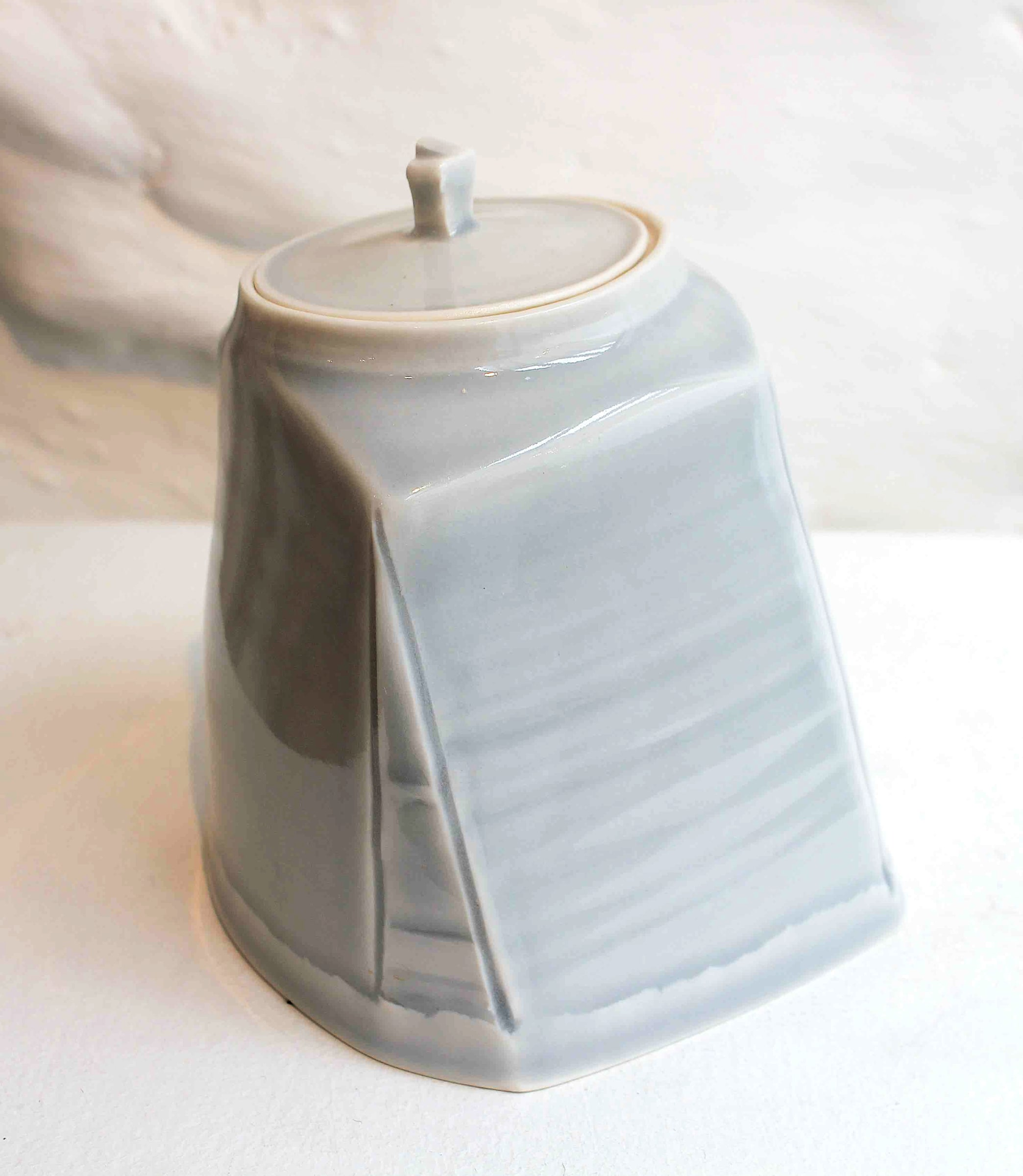 """<span class=""""link fancybox-details-link""""><a href=""""/artists/99-carina-ciscato/works/5765-carina-ciscato-pale-grey-blue-lidded-pot-2018/"""">View Detail Page</a></span><div class=""""artist""""><strong>Carina Ciscato</strong></div> b. 1970 <div class=""""title""""><em>Pale Grey/Blue Lidded Pot</em>, 2018</div> <div class=""""signed_and_dated"""">porcelain</div> <div class=""""medium"""">porcelain</div> <div class=""""dimensions"""">12 x 10 cm<br /> 4 3/4 x 4 inches</div><div class=""""price"""">£350.00</div><div class=""""copyright_line"""">OwnArt: £35 x 10 Months, 0% APR</div>"""