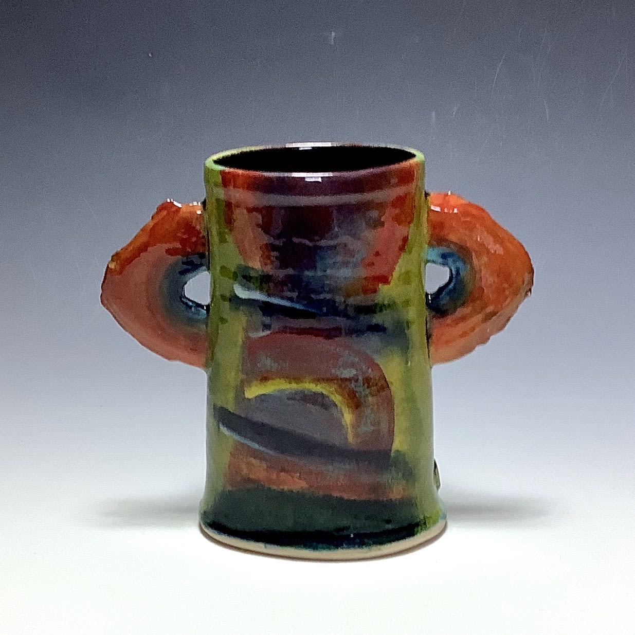 """<span class=""""link fancybox-details-link""""><a href=""""/artists/100-john-pollex/works/7853-john-pollex-winged-vase-2021/"""">View Detail Page</a></span><div class=""""artist""""><strong>John Pollex</strong></div> <div class=""""title""""><em>Winged Vase</em>, 2021</div> <div class=""""signed_and_dated"""">impressed with the artist's seal mark 'JP'</div> <div class=""""medium"""">white earthenware decorated with coloured slips</div> <div class=""""dimensions"""">height. 17 cm x diameter. 12 cm</div><div class=""""price"""">£176.00</div><div class=""""copyright_line"""">Own Art: £17.60 x 10 Months, 0% APR</div>"""