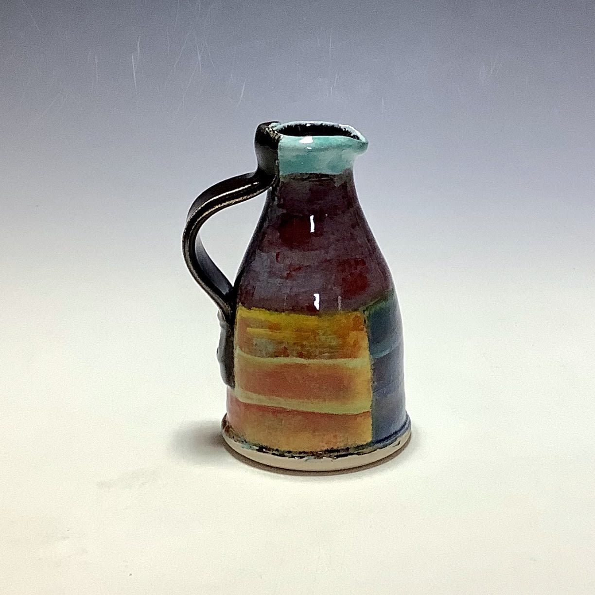 """<span class=""""link fancybox-details-link""""><a href=""""/artists/100-john-pollex/works/7843-john-pollex-small-jug-2021/"""">View Detail Page</a></span><div class=""""artist""""><strong>John Pollex</strong></div> <div class=""""title""""><em>Small Jug</em>, 2021</div> <div class=""""signed_and_dated"""">impressed with the artist's seal mark 'JP'</div> <div class=""""medium"""">white earthenware decorated with coloured slips</div> <div class=""""dimensions"""">height. 11 cm x diameter. 6.5 cm</div><div class=""""price"""">£66.00</div><div class=""""copyright_line"""">Own Art: £6.60 x 10 Months, 0% APR</div>"""