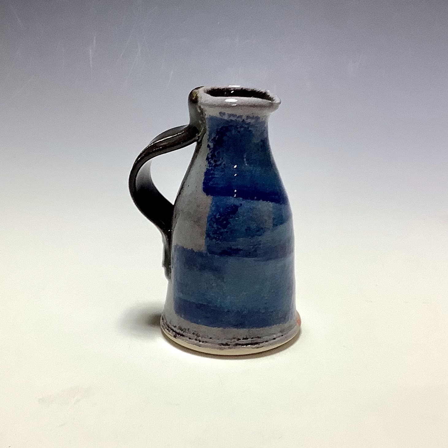 """<span class=""""link fancybox-details-link""""><a href=""""/artists/100-john-pollex/works/7842-john-pollex-small-jug-2021/"""">View Detail Page</a></span><div class=""""artist""""><strong>John Pollex</strong></div> <div class=""""title""""><em>Small Jug</em>, 2021</div> <div class=""""signed_and_dated"""">impressed with the artist's seal mark 'JP'</div> <div class=""""medium"""">white earthenware decorated with coloured slips</div> <div class=""""dimensions"""">height. 11 cm x diameter. 6 cm</div><div class=""""price"""">£66.00</div><div class=""""copyright_line"""">Own Art: £6.60 x 10 Months, 0% APR</div>"""