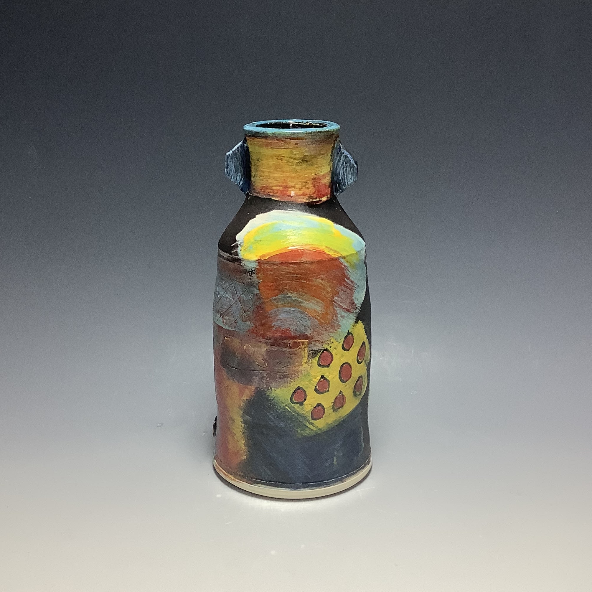 """<span class=""""link fancybox-details-link""""><a href=""""/artists/100-john-pollex/works/6831-john-pollex-bottle-with-neck-attachment-2020/"""">View Detail Page</a></span><div class=""""artist""""><strong>John Pollex</strong></div> b. 1941 <div class=""""title""""><em>Bottle with neck attachment</em>, 2020</div> <div class=""""signed_and_dated"""">impressed with the artist's seal mark 'JP'</div> <div class=""""medium"""">white earthenware decorated with coloured slips</div> <div class=""""dimensions"""">h. 8.5in</div><div class=""""copyright_line"""">Ownart: £22 x 19 Months, 0% APR</div>"""