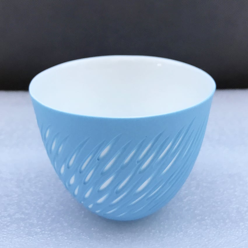 """<span class=""""link fancybox-details-link""""><a href=""""/artists/60-sasha-wardell/works/7487-sasha-wardell-shoal-tea-bowl-2021/"""">View Detail Page</a></span><div class=""""artist""""><strong>Sasha Wardell</strong></div> b. 1956 <div class=""""title""""><em>'Shoal' Tea Bowl</em>, 2021</div> <div class=""""signed_and_dated"""">inscribed with artist's initials to base</div> <div class=""""medium"""">blue/white layered and sliced bone china</div> <div class=""""dimensions"""">h. 6.5 cm x dia. 8 cm</div><div class=""""price"""">£75.00</div>"""
