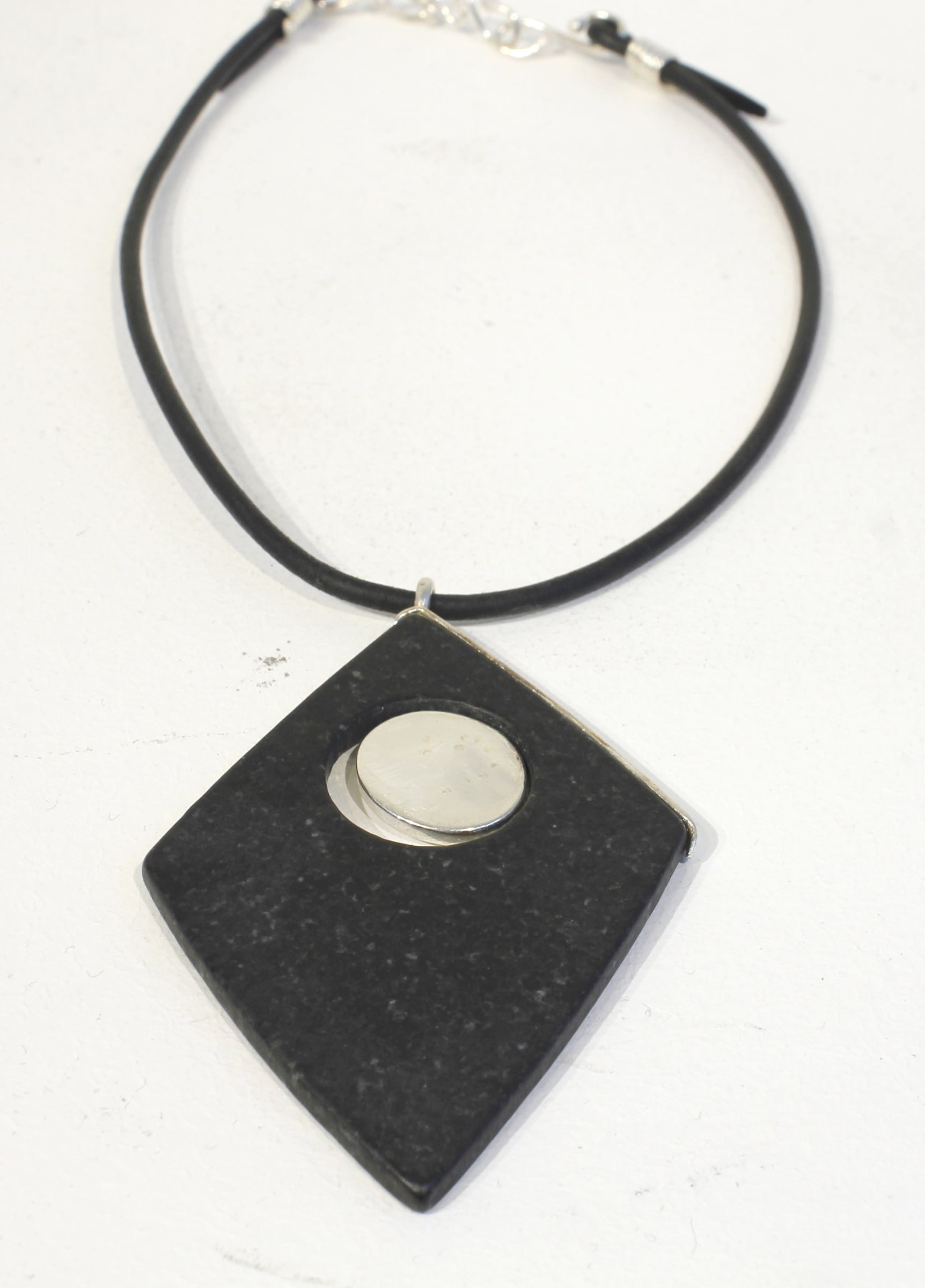 "<span class=""link fancybox-details-link""><a href=""/artists/186-helen-feiler/works/4632-helen-feiler-pendeen-granite-pendant/"">View Detail Page</a></span><div class=""artist""><strong>Helen Feiler</strong></div> <div class=""title""><em>Pendeen Granite Pendant </em></div> <div class=""medium"">Silver and Granite </div><div class=""price"">£250.00</div><div class=""copyright_line"">OwnArt: £ 25 x 10 Months, 0% APR</div>"