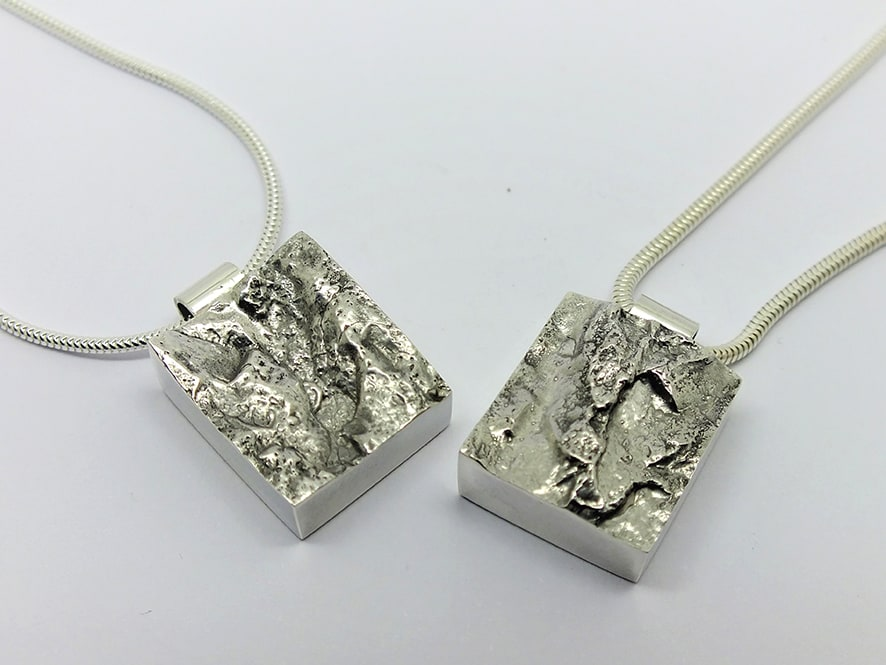 """<span class=""""link fancybox-details-link""""><a href=""""/artists/154-stacey-west/works/4909-stacey-west-interlocking-strata-pendant-pair-porthgwidden-2017/"""">View Detail Page</a></span><div class=""""artist""""><strong>Stacey West</strong></div> <div class=""""title""""><em>'Interlocking Strata' Pendant pair – 'Porthgwidden''</em>, 2017</div> <div class=""""medium"""">Solid sterling silver</div><div class=""""price"""">£275.00</div><div class=""""copyright_line"""">Copyright The Artist</div>"""