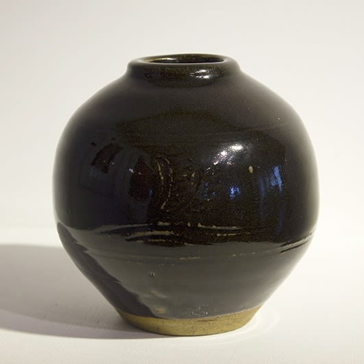 """<span class=""""link fancybox-details-link""""><a href=""""/artists/131-bernard-leach-ch-cbe/works/3020-bernard-leach-ch-cbe-vase-c.-1958/"""">View Detail Page</a></span><div class=""""artist""""><strong>Bernard Leach CH CBE</strong></div> 1887–1979 <div class=""""title""""><em>Vase</em>, c. 1958</div> <div class=""""signed_and_dated"""">Impressed 'BL' seal-mark alongside the Leach Pottery and 'ENGLAND' marks</div> <div class=""""medium"""">Reduced stoneware with tenmoku glaze, incised motifs within two bands of incised lines</div> <div class=""""dimensions"""">H 14 cm<br />5 1/2 inches<br />Dia. 14 cm<br />5 1/2 inches</div><div class=""""copyright_line"""">The estate of Bernard Leach</div>"""